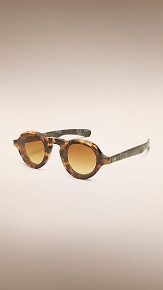 Óculos de sol com armação redonda de aparência de chifre