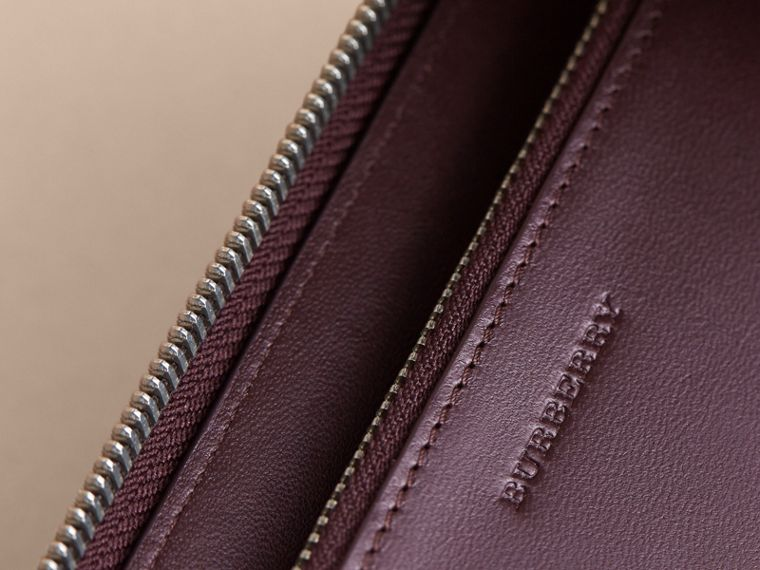 London Check Ziparound Wallet in Deep Claret - Men | Burberry Australia - cell image 1