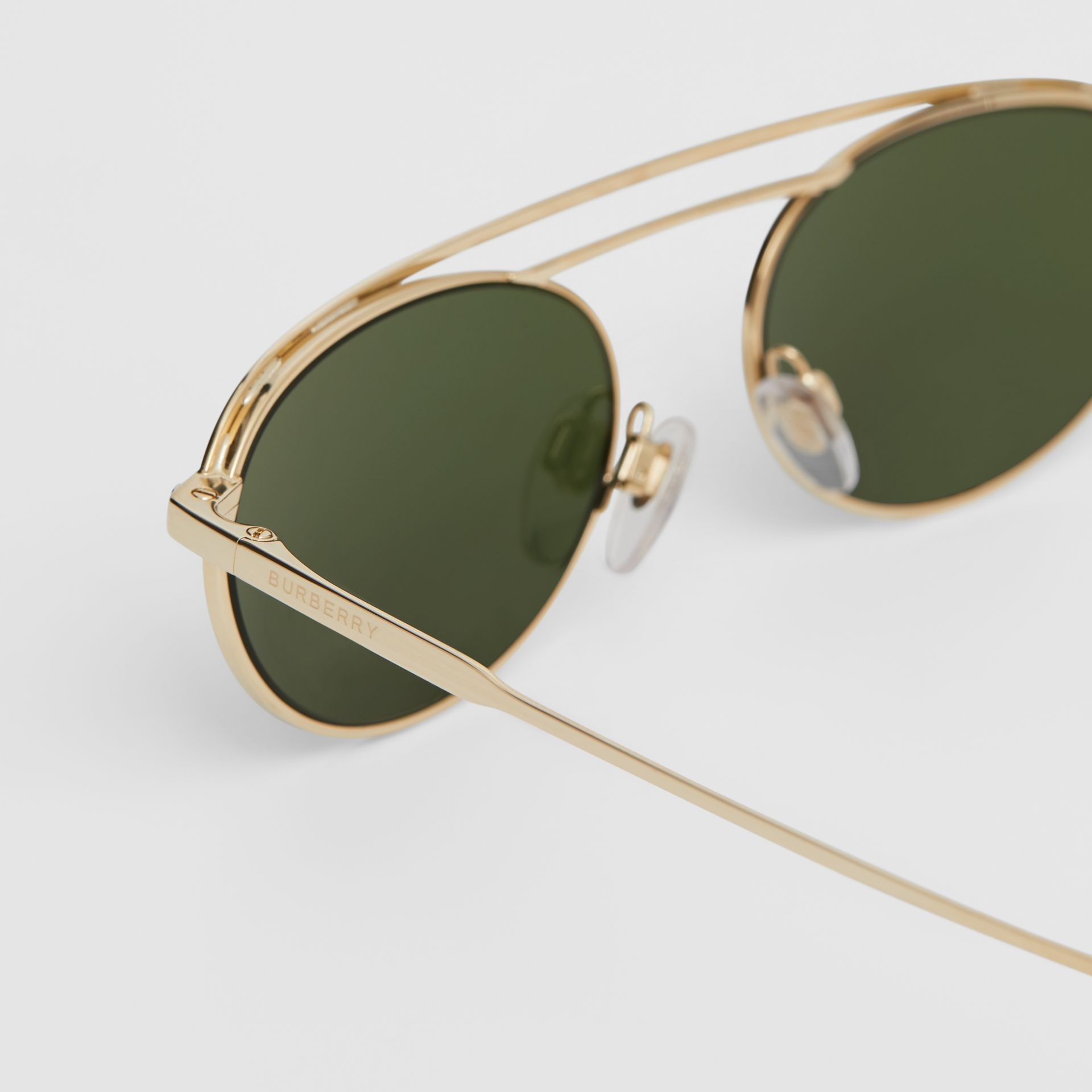 Oval Frame Sunglasses in Green - Women | Burberry - gallery image 1