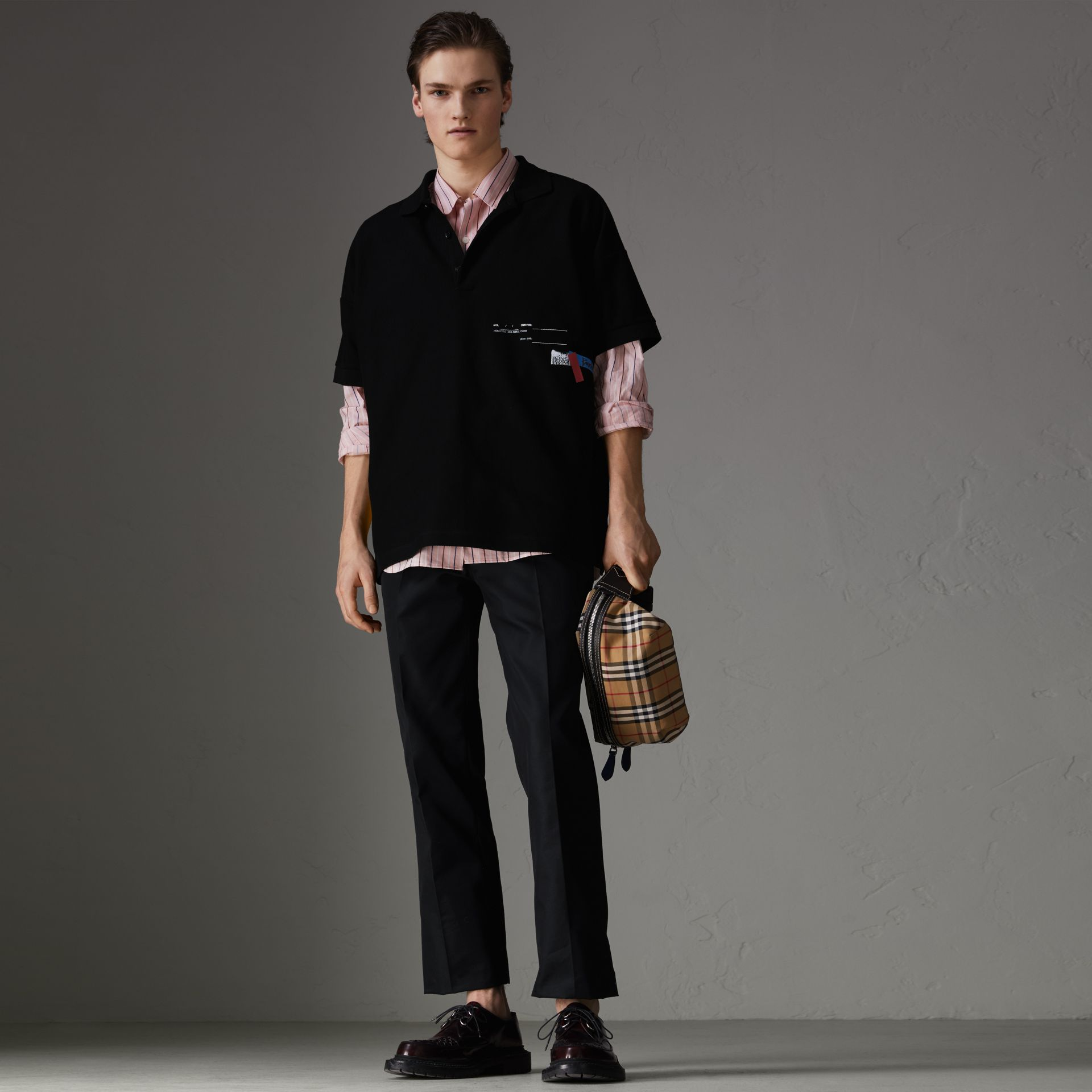 Sport Stripe Oversized Polo Shirt in Black - Men | Burberry - gallery image 0