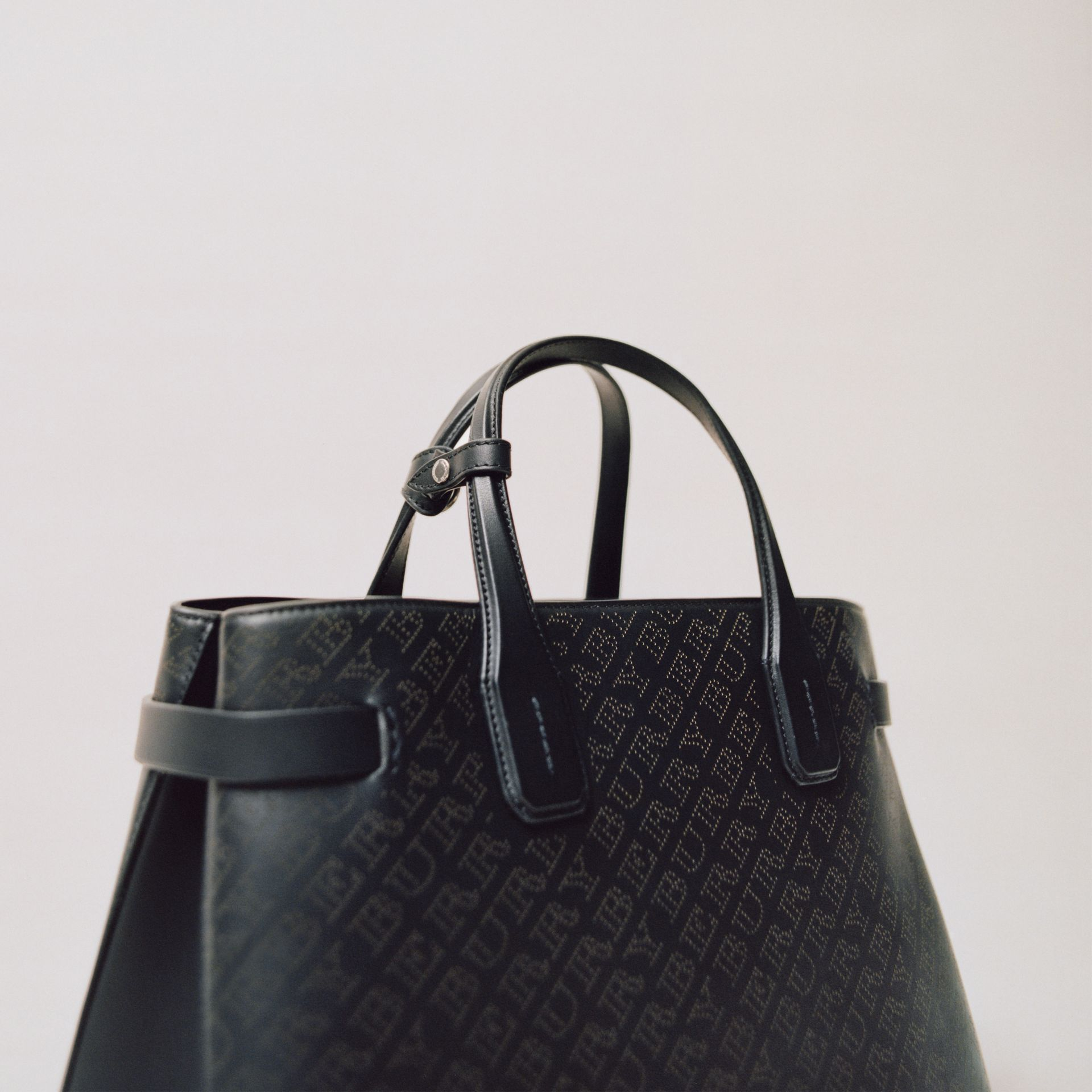 The Small Banner in Perforated Logo Leather in Black - Women | Burberry Australia - gallery image 1