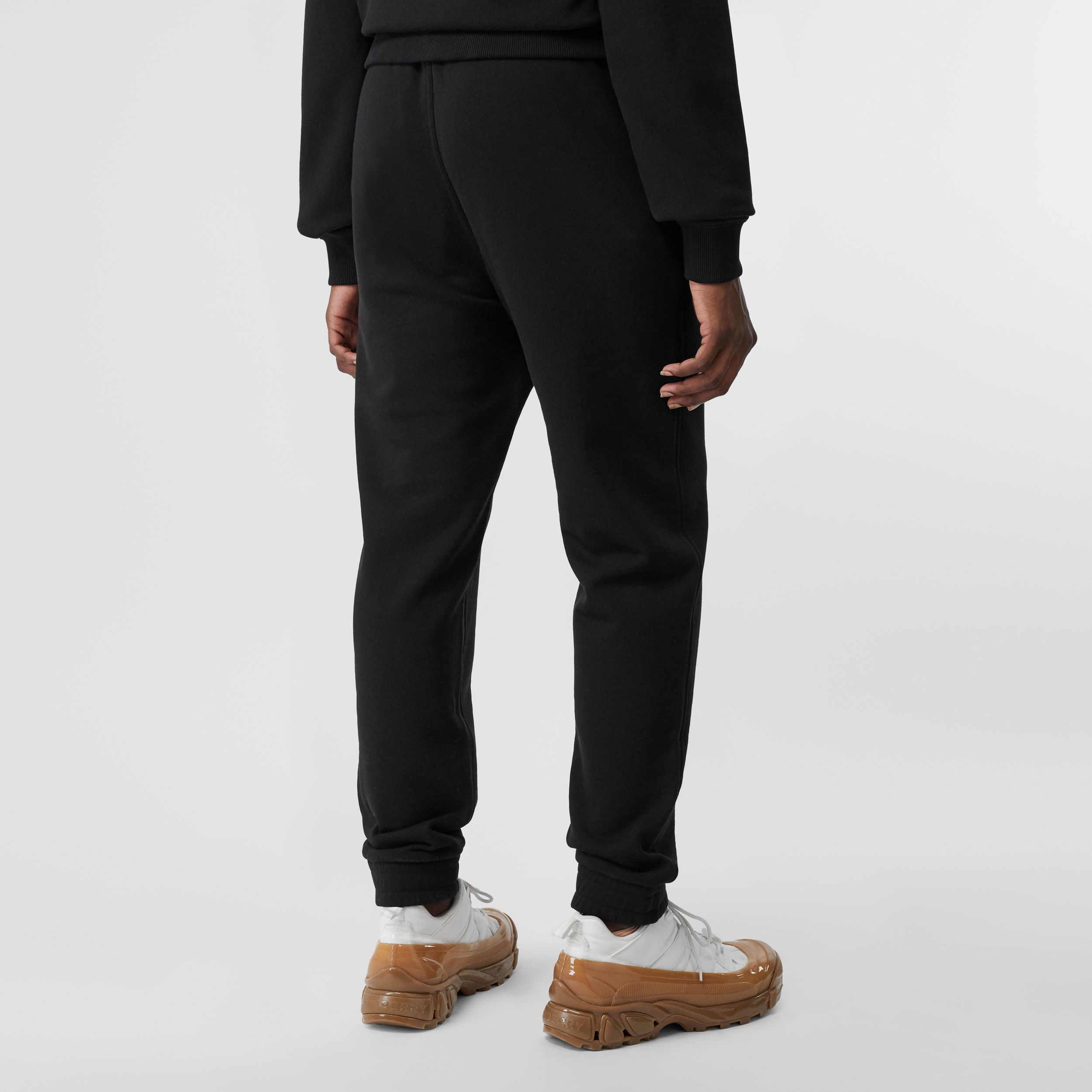Monogram Motif Cotton Jogging Pants in Black - Women | Burberry - 3