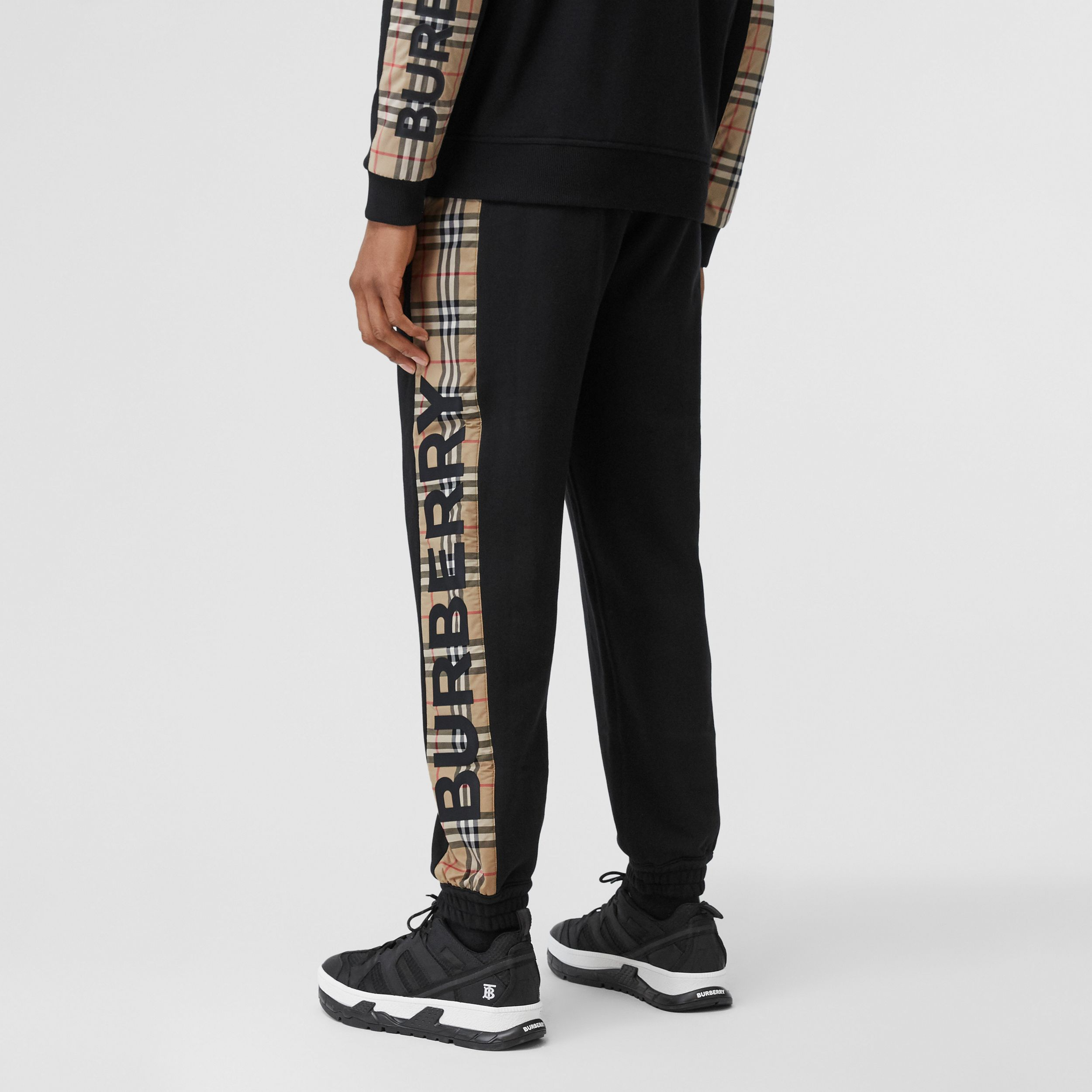 Logo Print Check Panel Cotton Jogging Pants in Black - Men | Burberry - 3