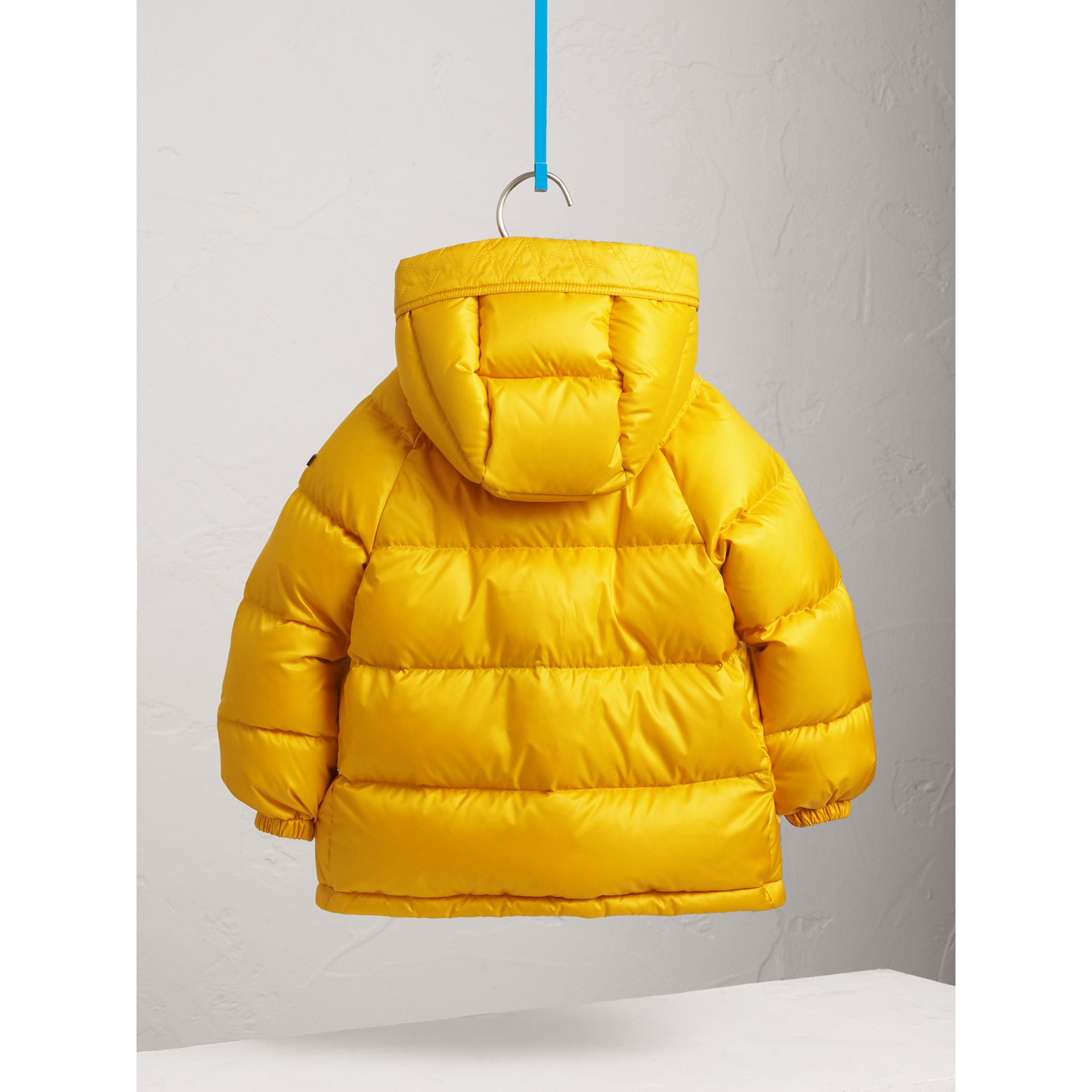 Shower-resistant Hooded Puffer Jacket in Larch Yellow - Boy | Burberry - gallery image 4