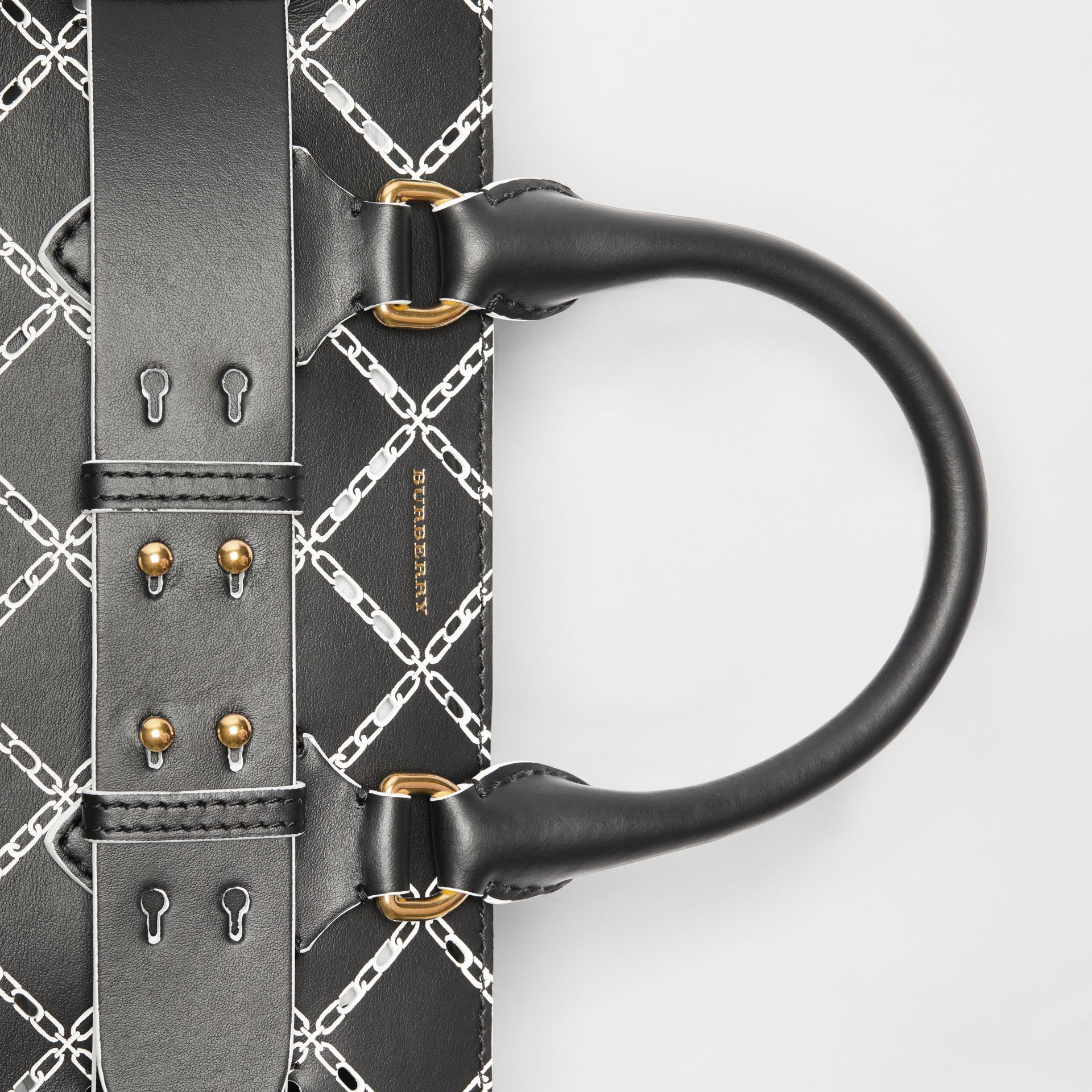 The Small Perforated Link Leather Belt Bag in Black - Women | Burberry United Kingdom - gallery image 1