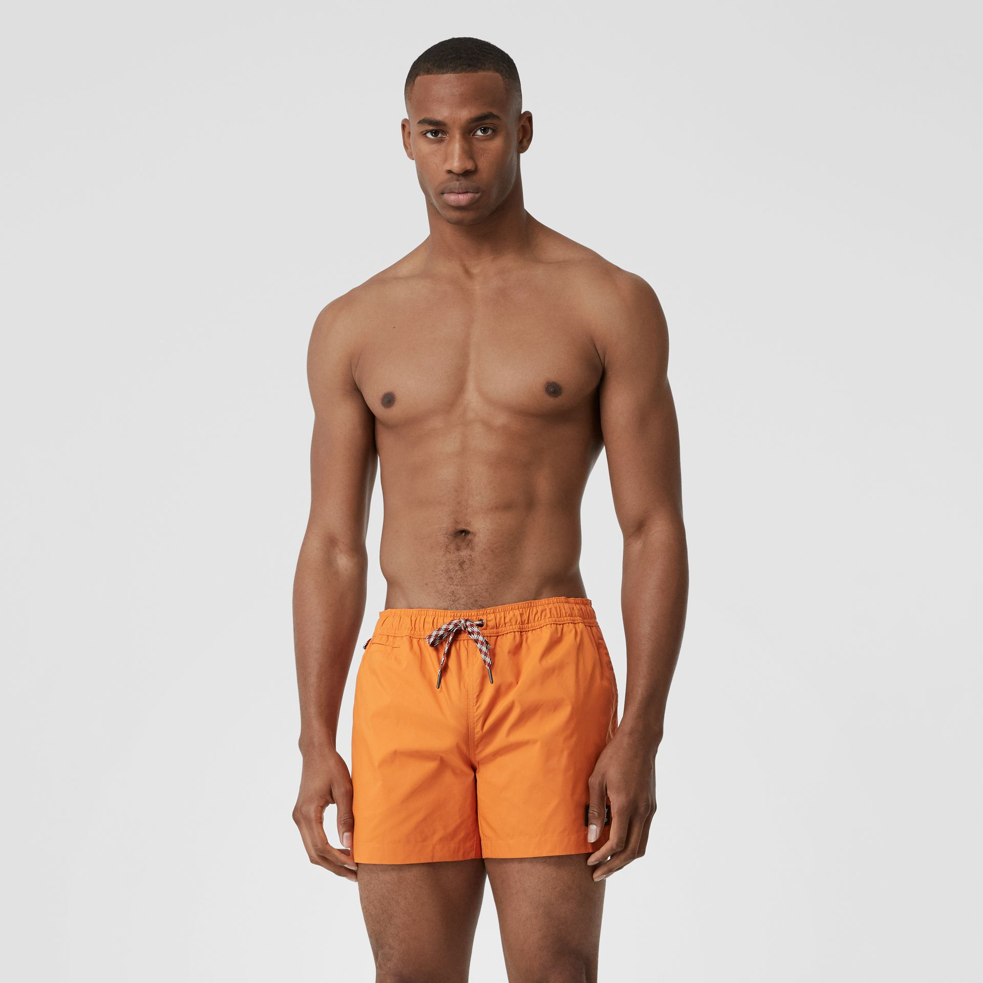 Logo Appliqué Drawcord Swim Shorts in Bright Orange - Men | Burberry United Kingdom - gallery image 0