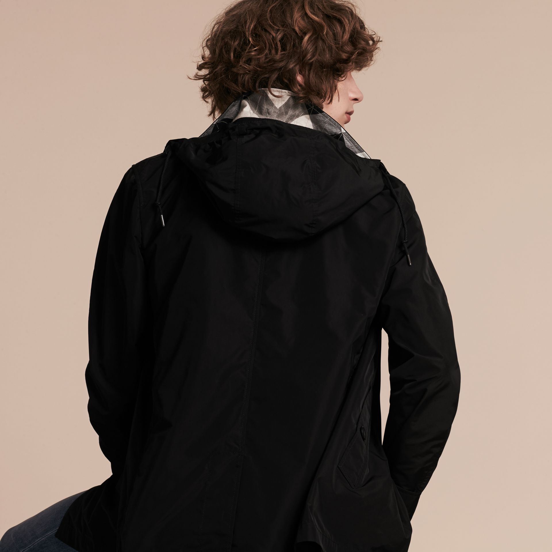 Showerproof Hooded Jacket with Removable Warmer in Black - Men | Burberry - gallery image 3