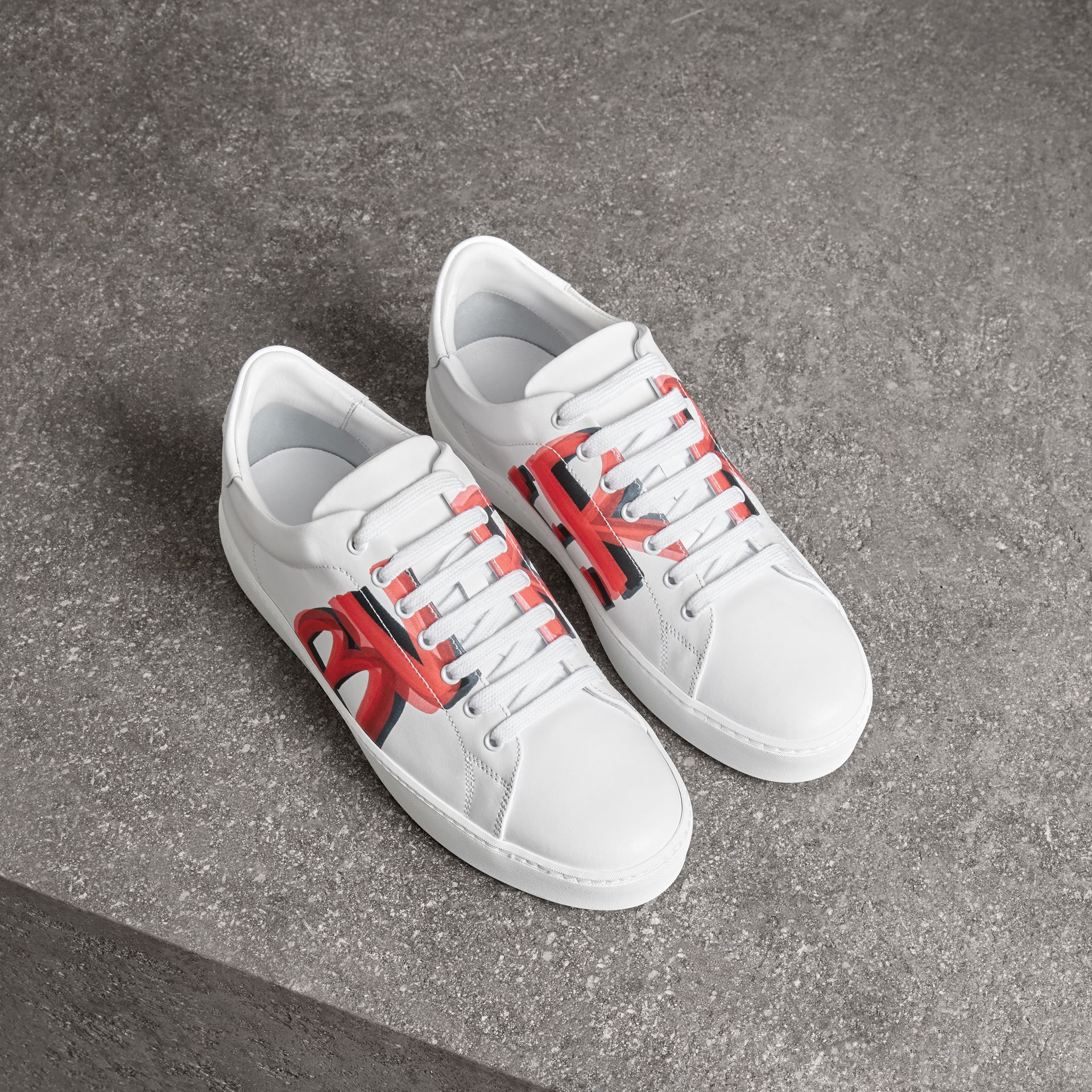 Graffiti Print Leather Sneakers in Bright Red - Women | Burberry - gallery image 0