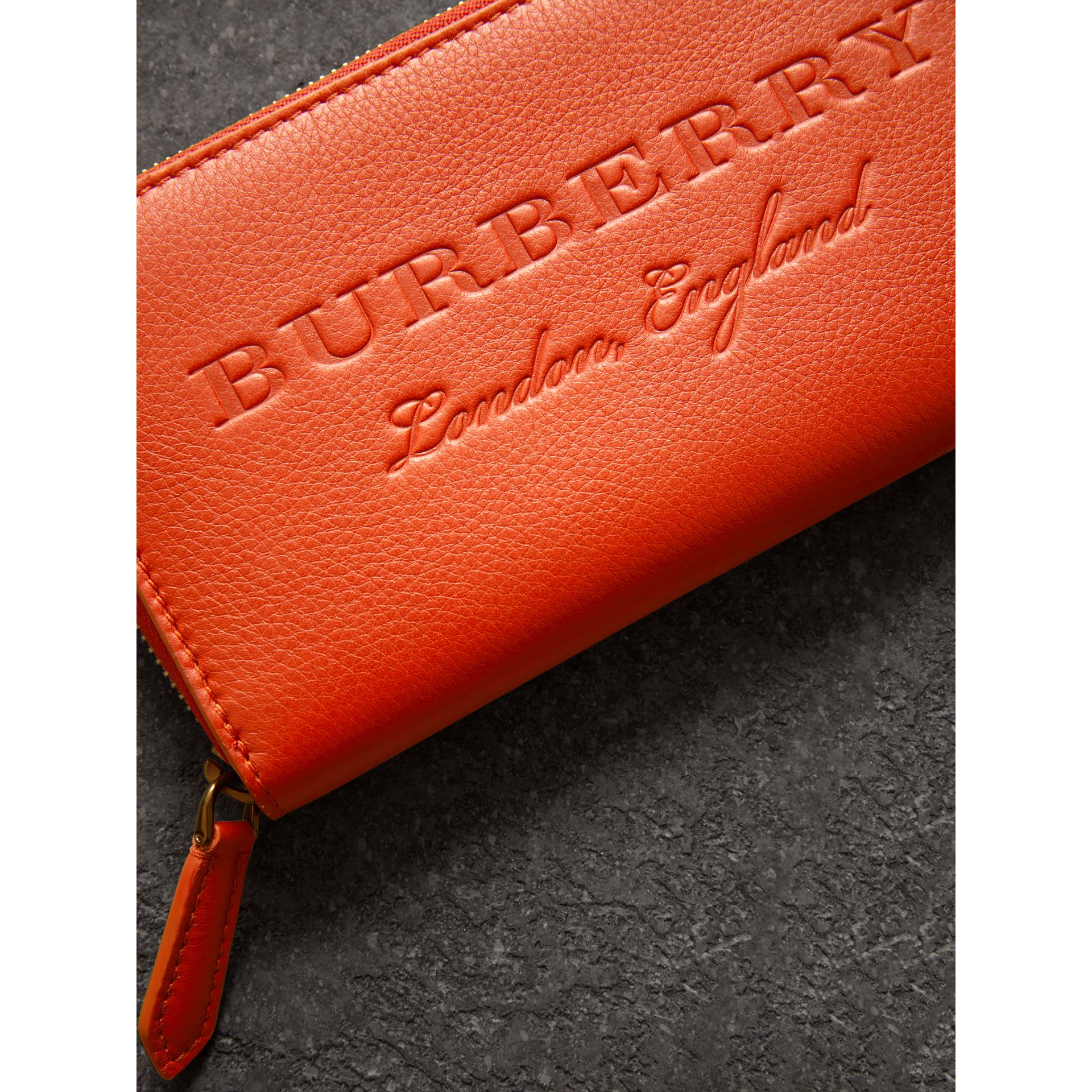 Embossed Leather Ziparound Wallet in Dark Clementine - Women | Burberry United Kingdom - gallery image 1