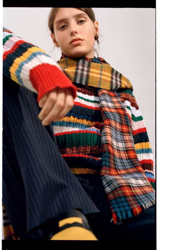 Ella pairs stripes and checks for clash appeal.