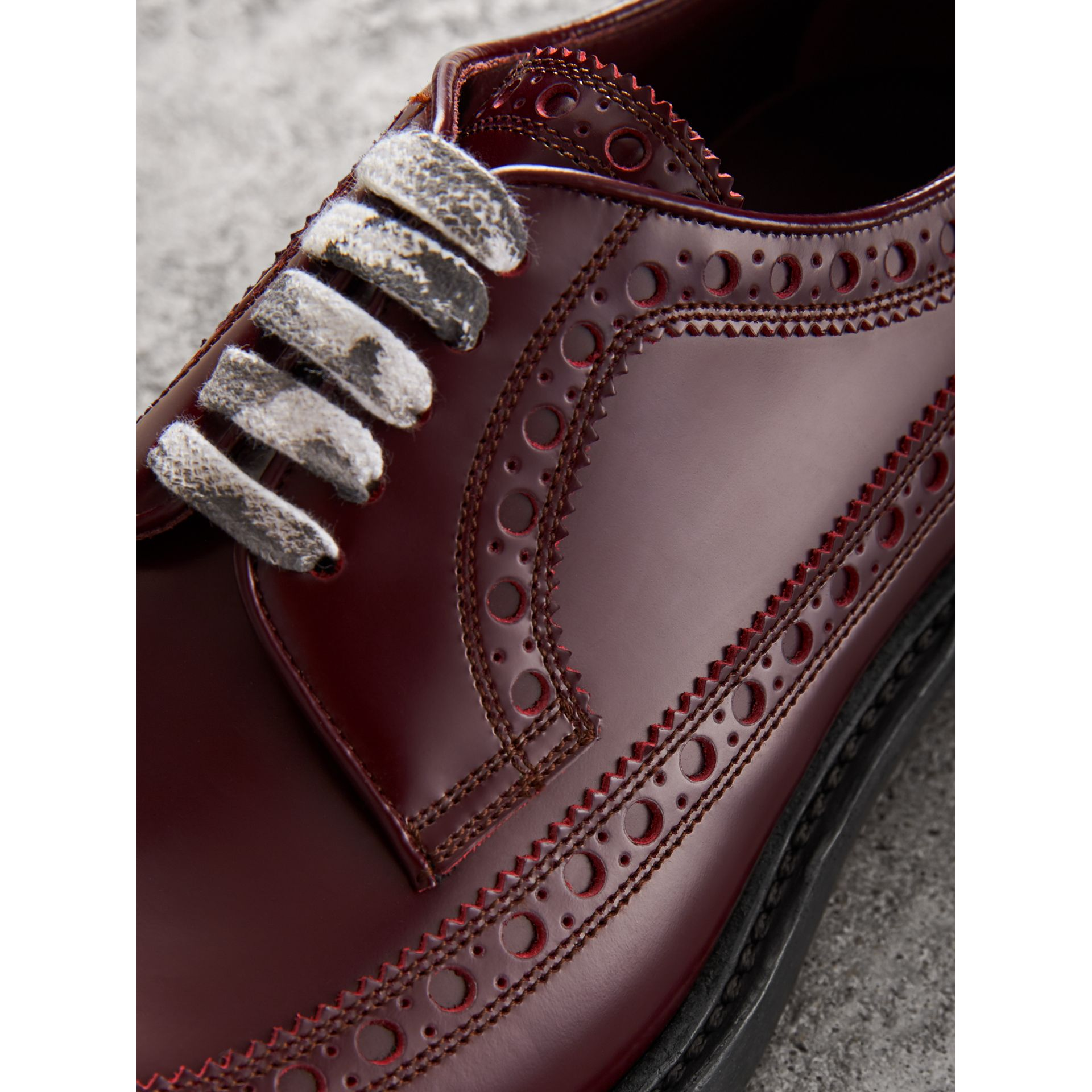 Leather Brogues with Painted Laces in Ebony Red - Men | Burberry United Kingdom - gallery image 1