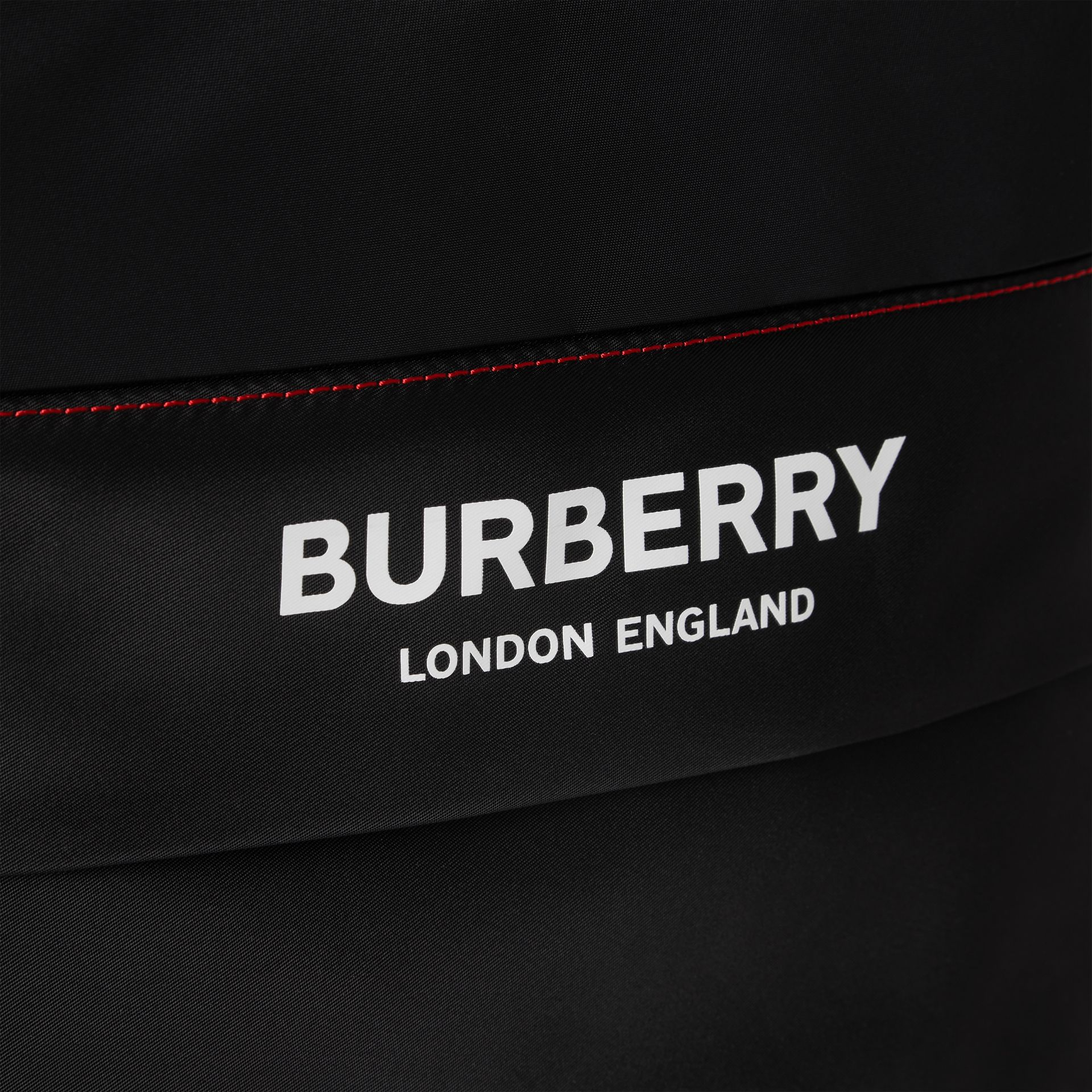 Logo Print Backpack in Black - Children | Burberry - gallery image 1