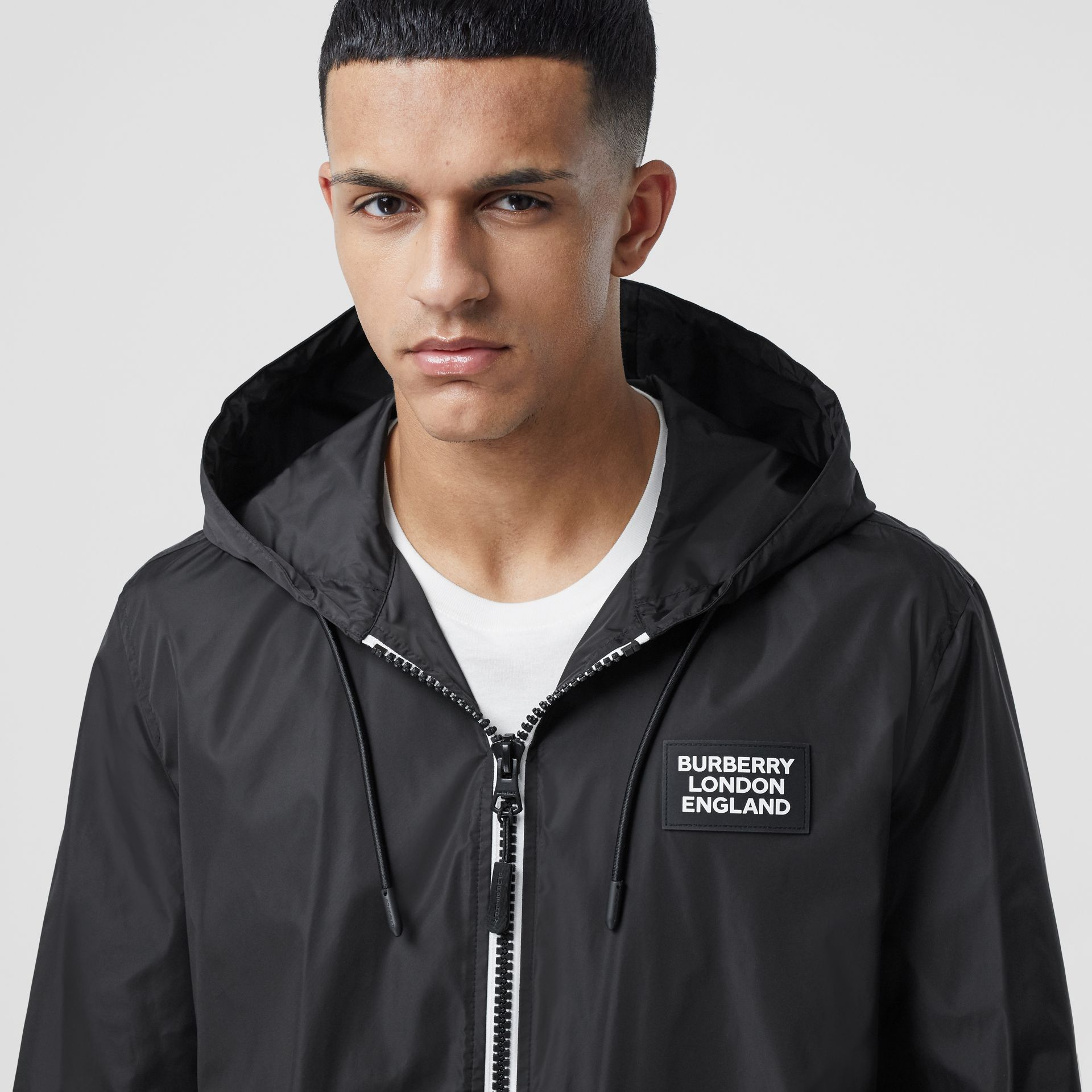 Logo Appliqué ECONYL® Lightweight Hooded Jacket in Black - Men | Burberry - gallery image 1