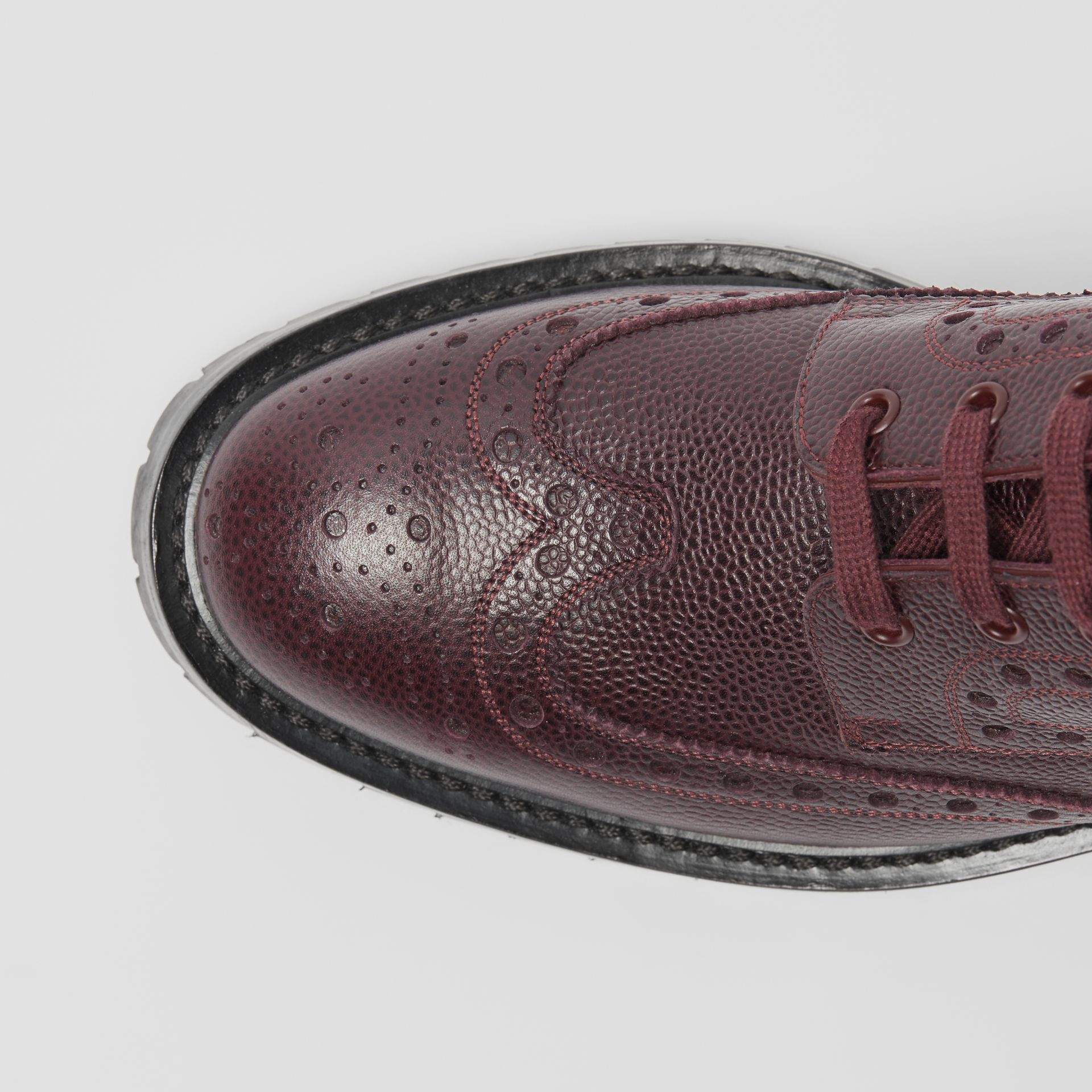 Brogue Detail Grainy Leather Boots in Bordeaux - Men | Burberry United Kingdom - gallery image 1