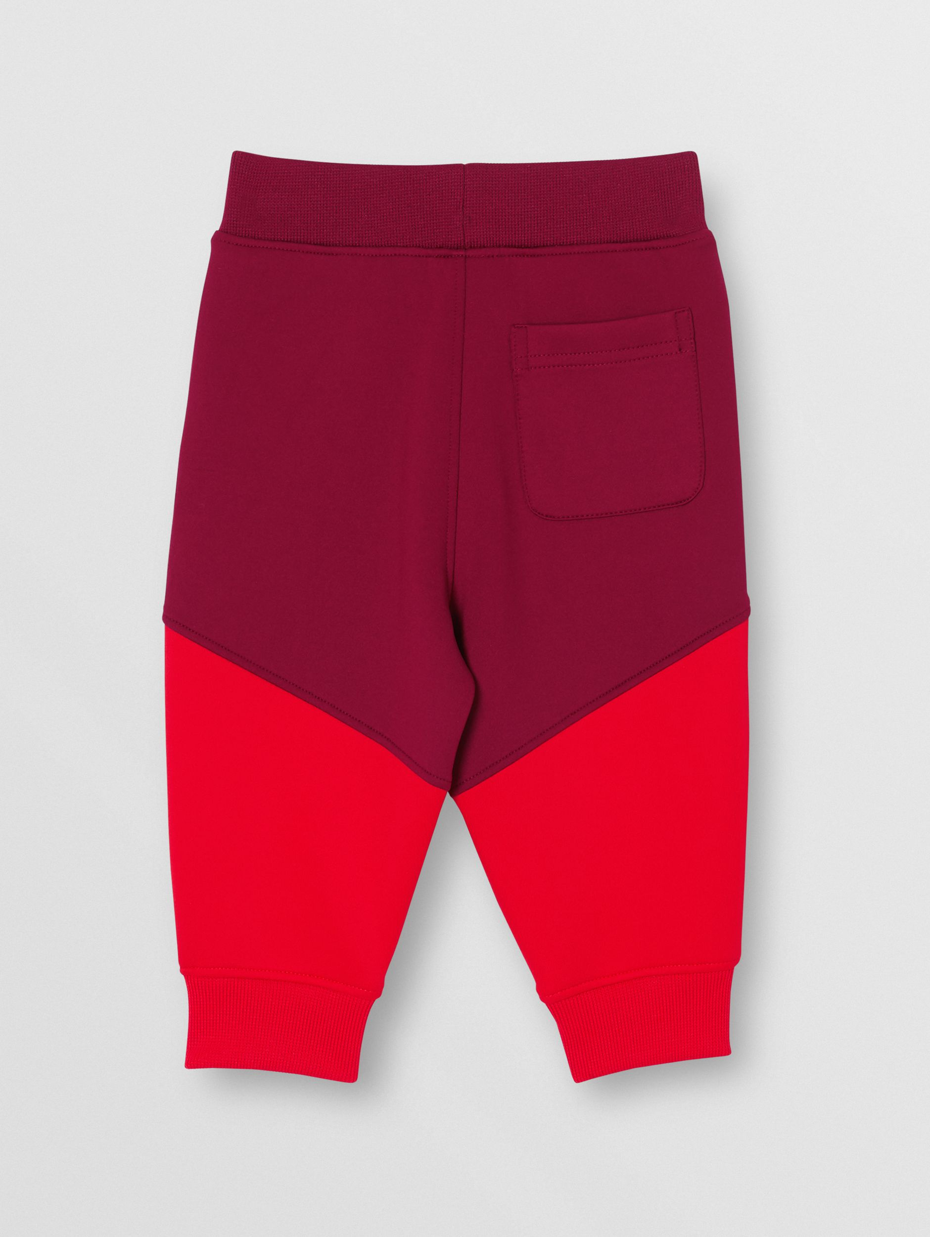 Logo Print Two-tone Stretch Jersey Trackpants in Dark Burgundy - Children | Burberry - 4