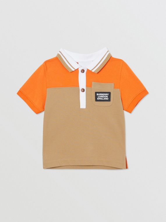 Poloshirt aus Baumwollpiqué in Colour-Blocking-Optik (Hellorange)