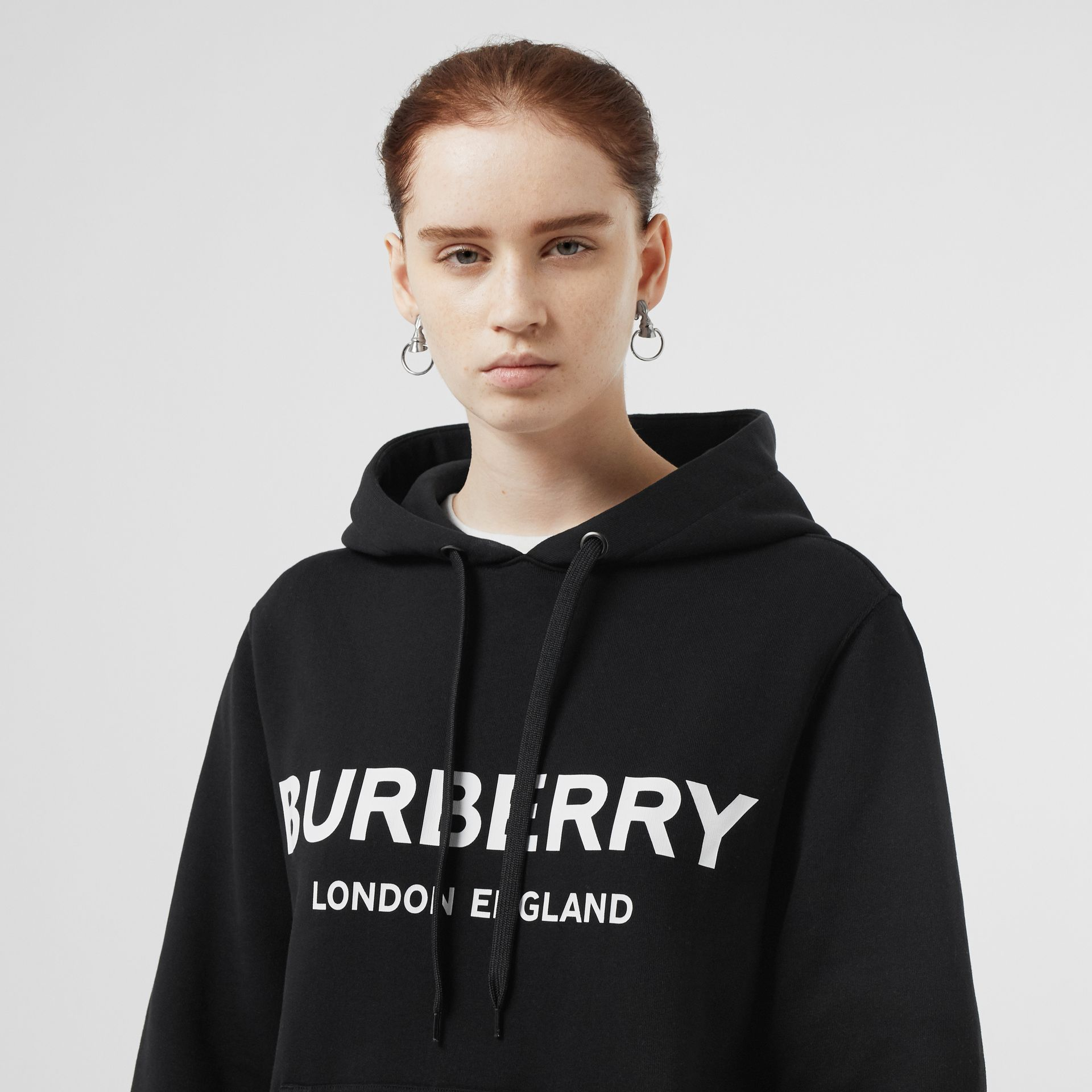 Logo Print Cotton Oversized Hoodie in Black - Women | Burberry Singapore - gallery image 1