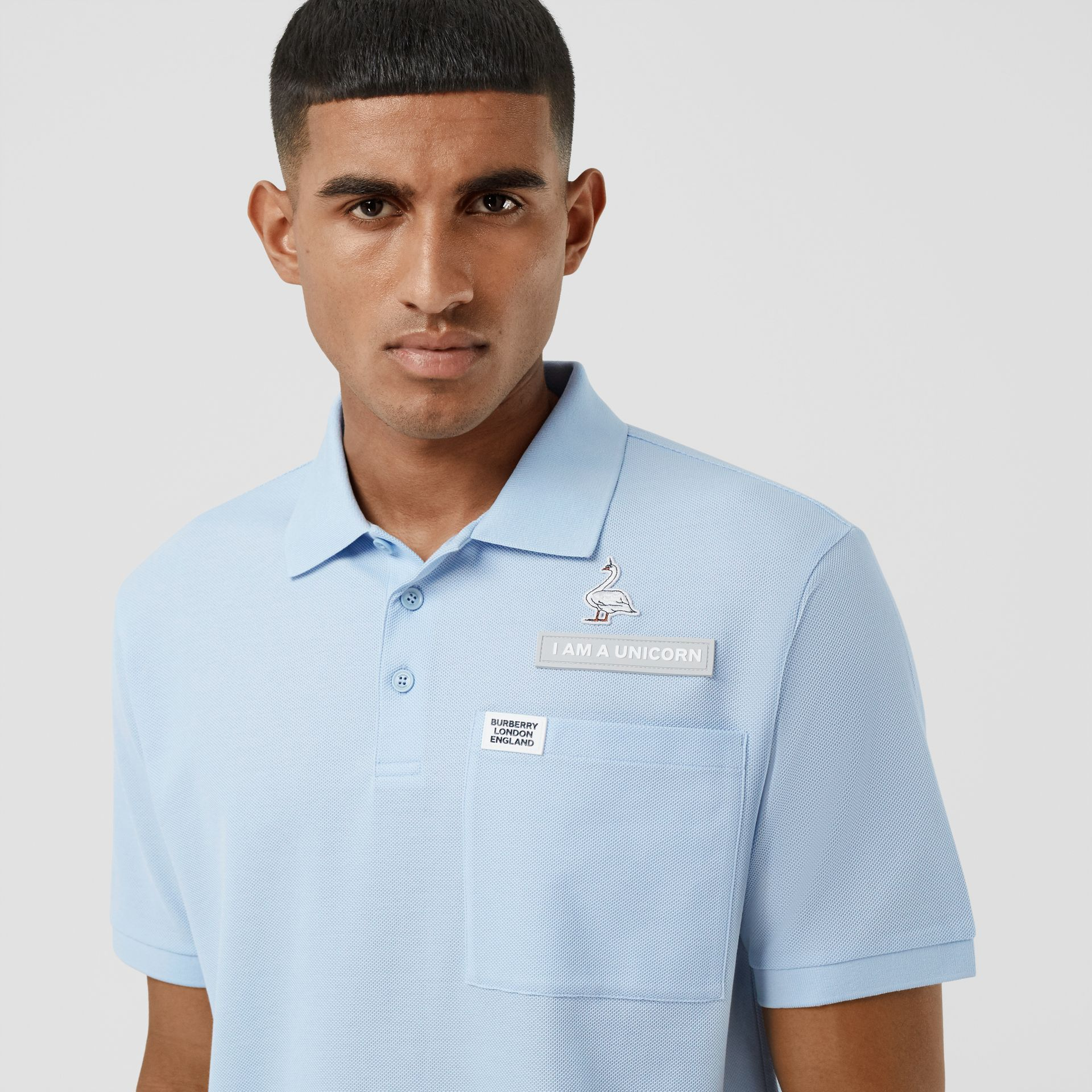 Swan and Slogan Appliqué Cotton Polo Shirt in Pale Blue - Men   Burberry United Kingdom - gallery image 1