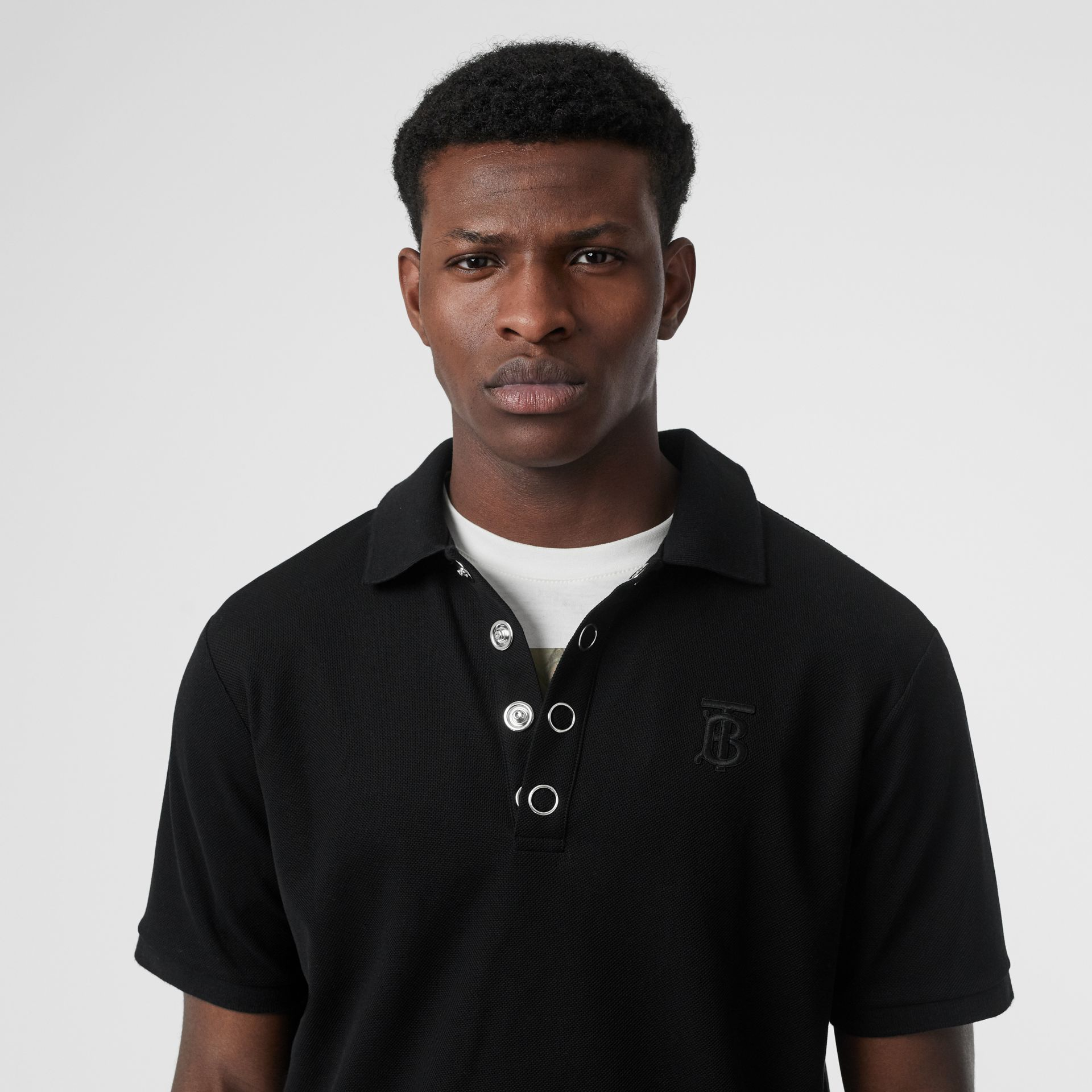 Monogram Motif Cotton Piqué Polo Shirt in Black | Burberry United States - gallery image 1