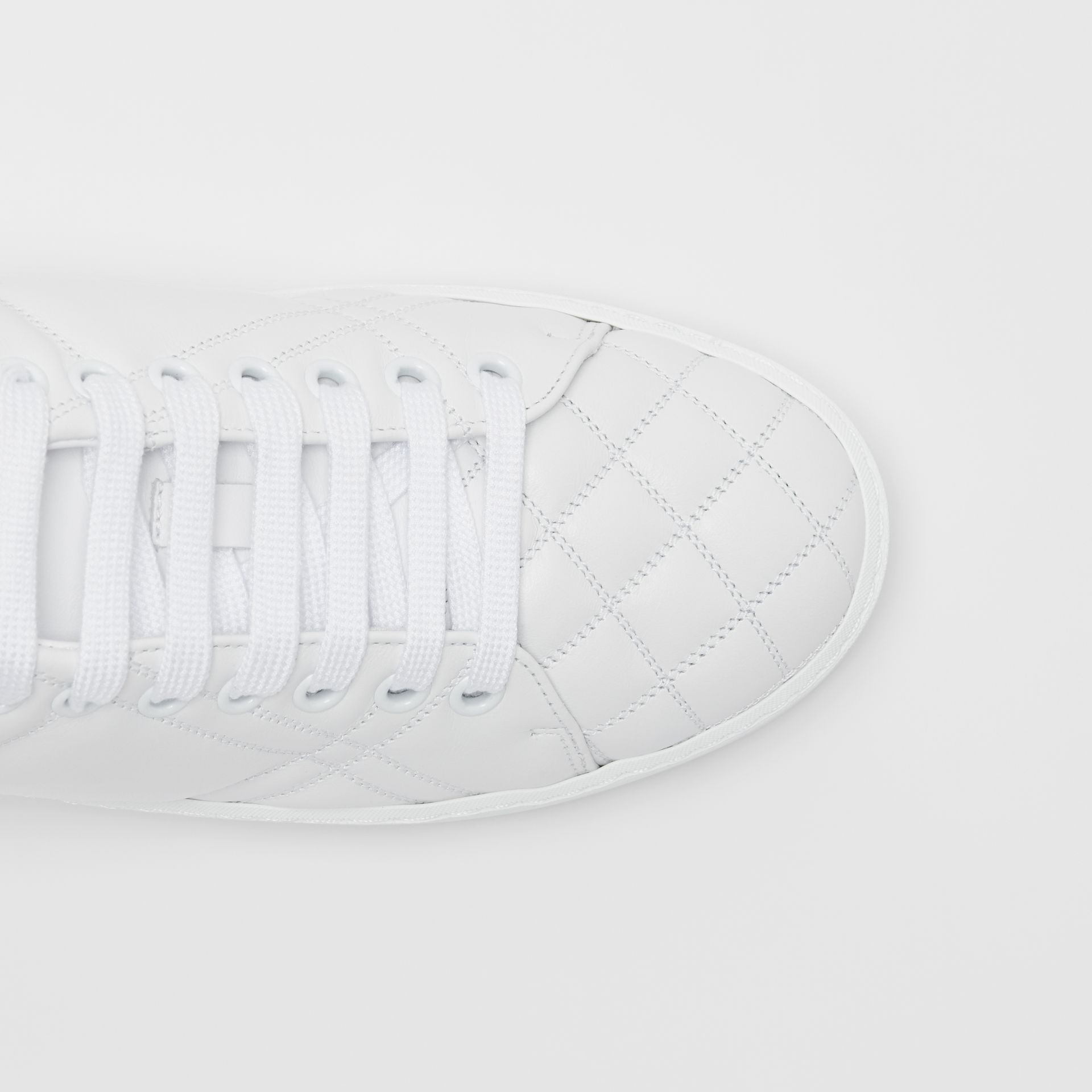 Check-quilted Leather Sneakers in Optic White - Women | Burberry - gallery image 1