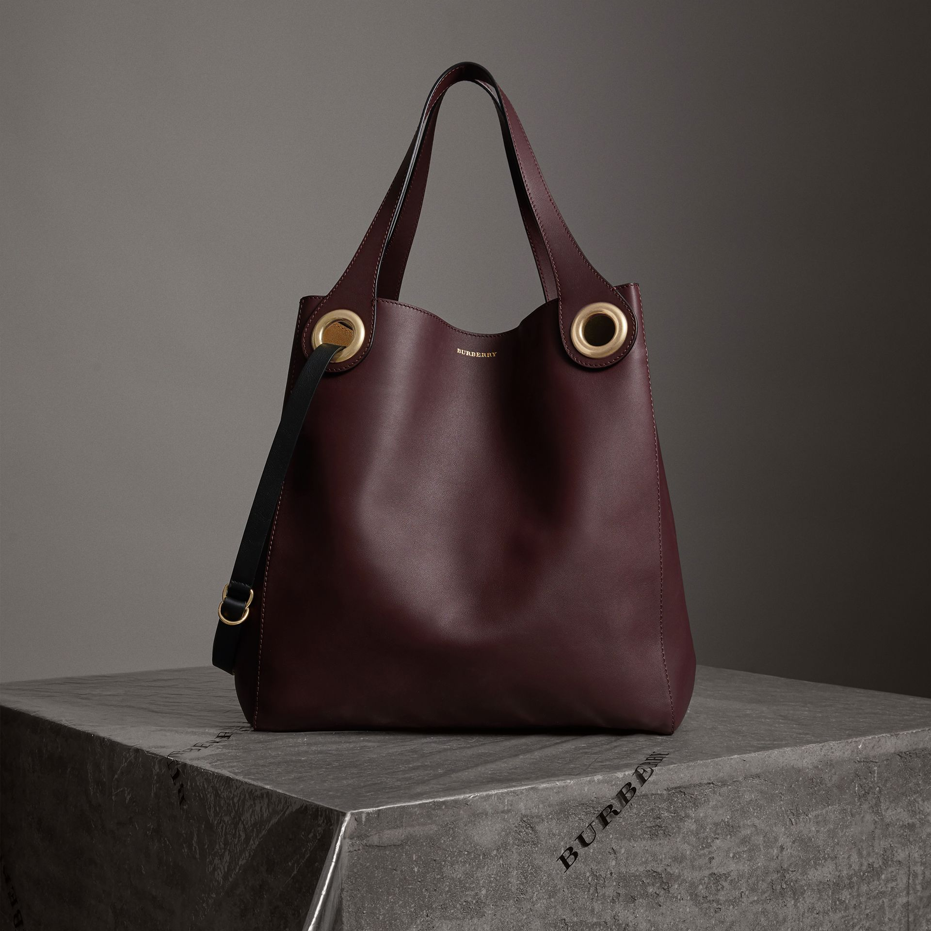 The Large Leather Grommet Detail Tote in Deep Claret | Burberry United Kingdom - gallery image 0