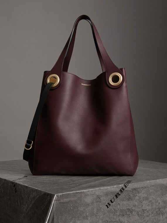 The Large Leather Grommet Detail Tote in Deep Claret