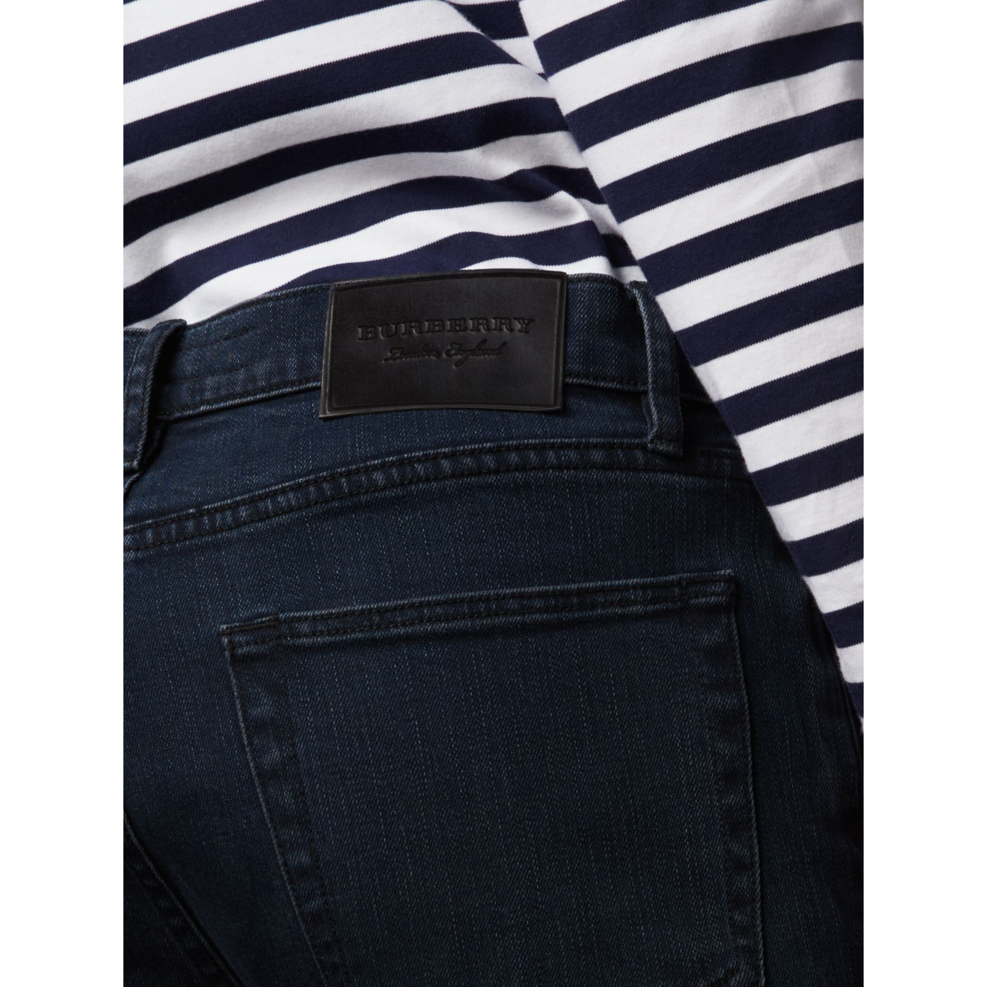 Slim Fit Over-dyed Stretch Jeans in Dark Indigo - Men | Burberry - gallery image 1