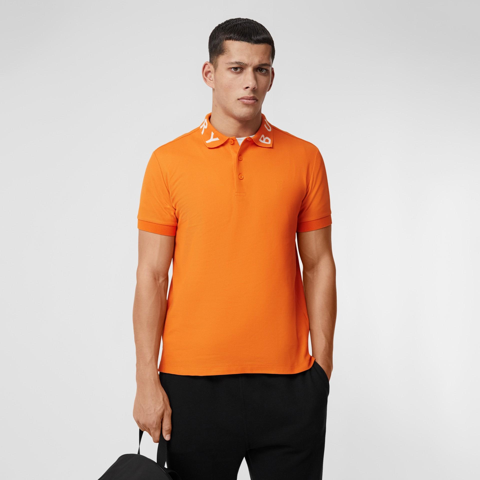 Polo in cotone piqué con logo a intarsio (Arancione Intenso) - Uomo | Burberry - immagine della galleria 4