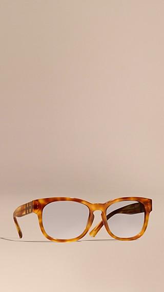 Óculos de sol com armação quadrada e detalhe xadrez