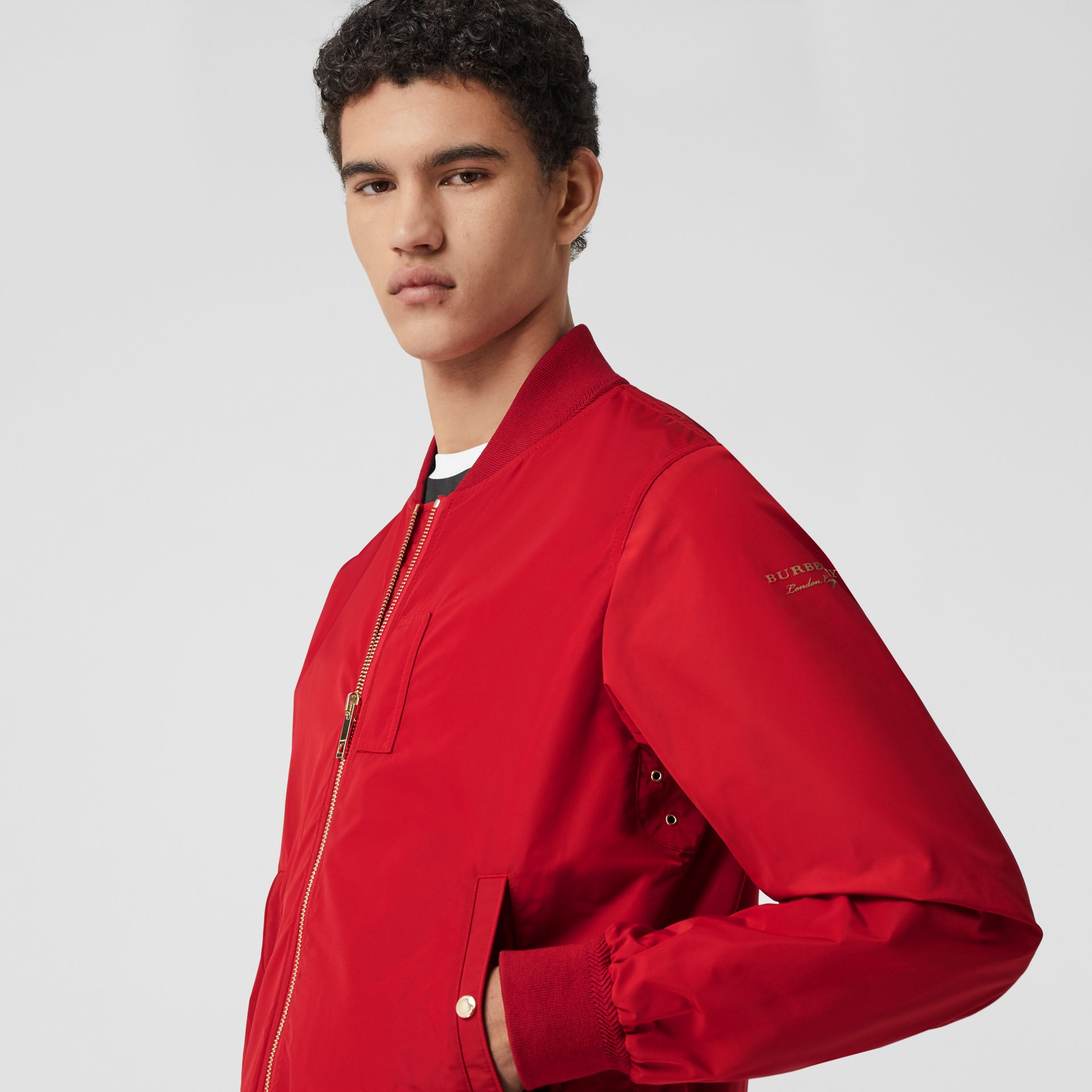 Logo Print Shape-memory Taffeta Bomber Jacket in Military Red - Men | Burberry - gallery image 1