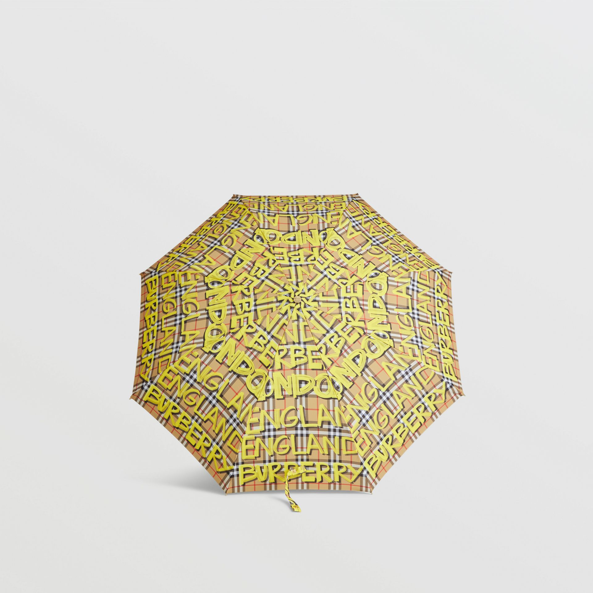 Graffiti Vintage Check Print Folding Umbrella in Yellow | Burberry Canada - gallery image 2