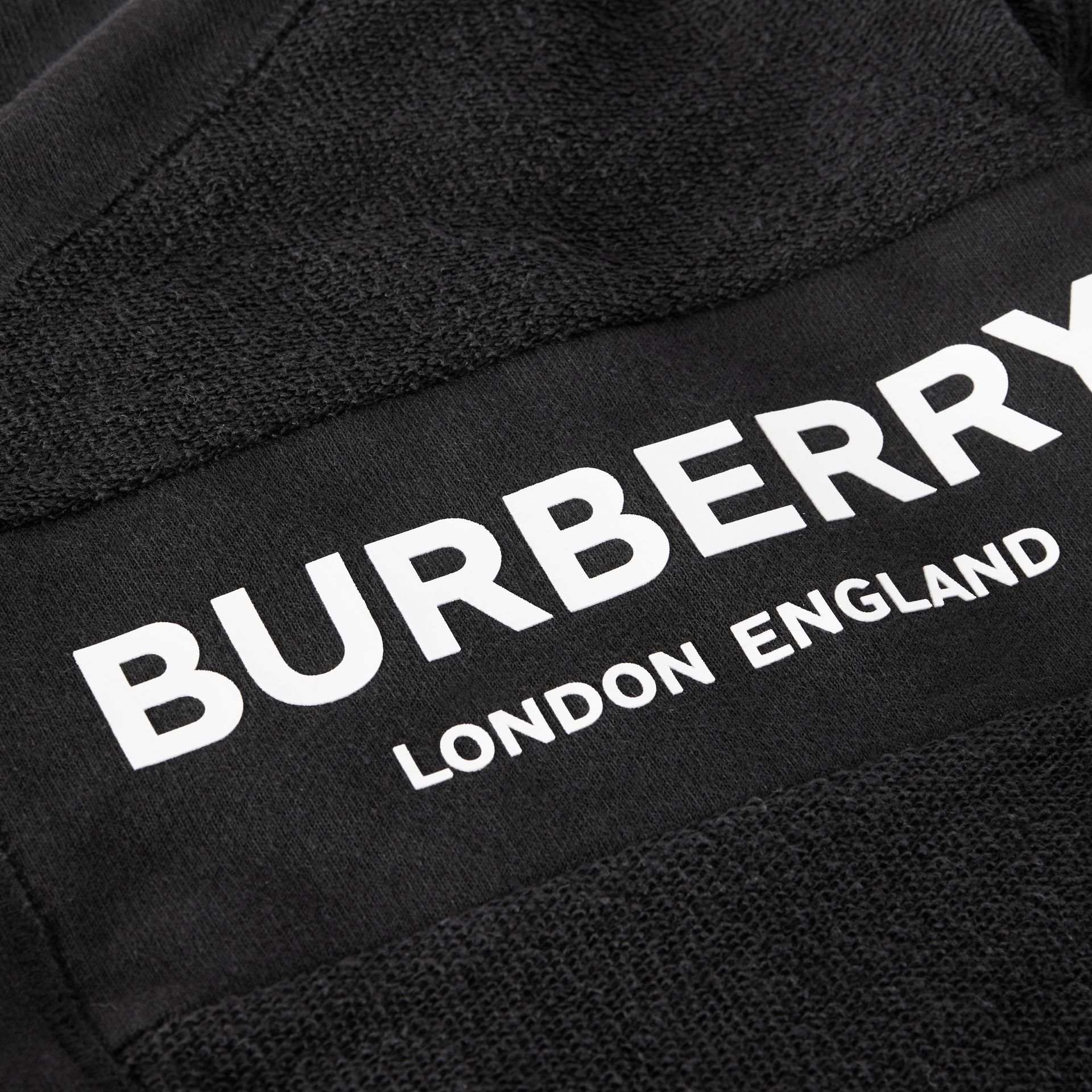 Logo Print Quilted Cotton Jumpsuit in Black - Children | Burberry United Kingdom - gallery image 1