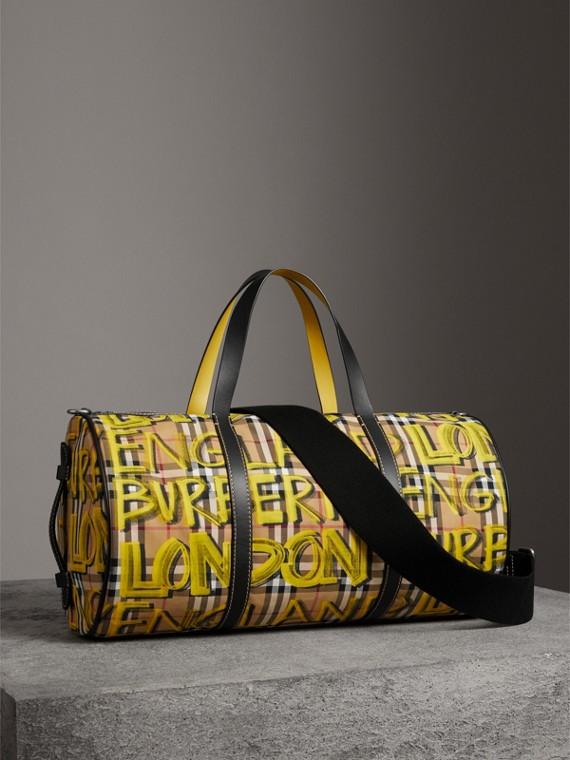 Borsa a cilindro media con motivo Vintage check e stampa graffiti (Giallo Intenso/giallo Antico)