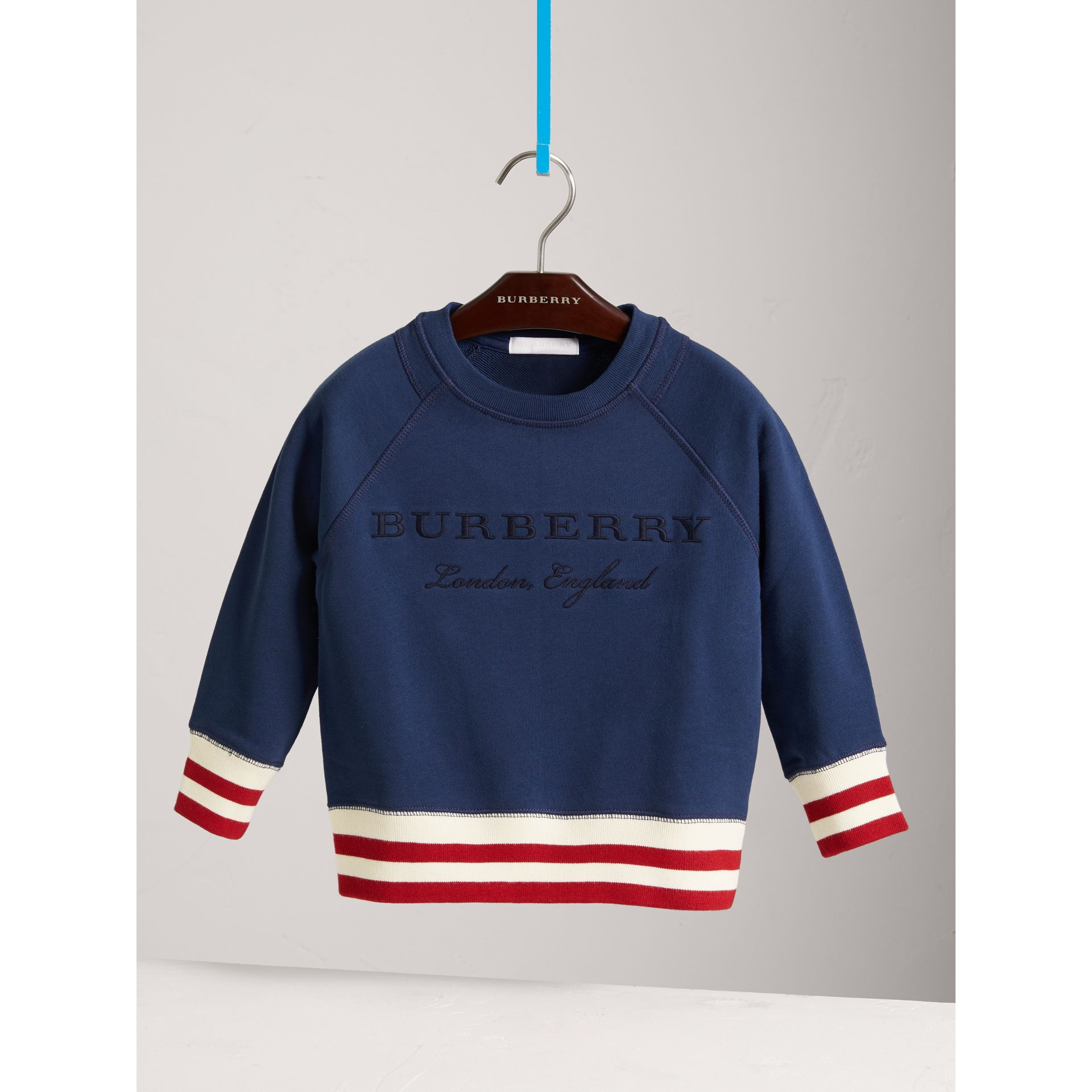 Striped Hem Embroidered Cotton Jersey Sweatshirt in Canvas Blue - Boy | Burberry Singapore - gallery image 0