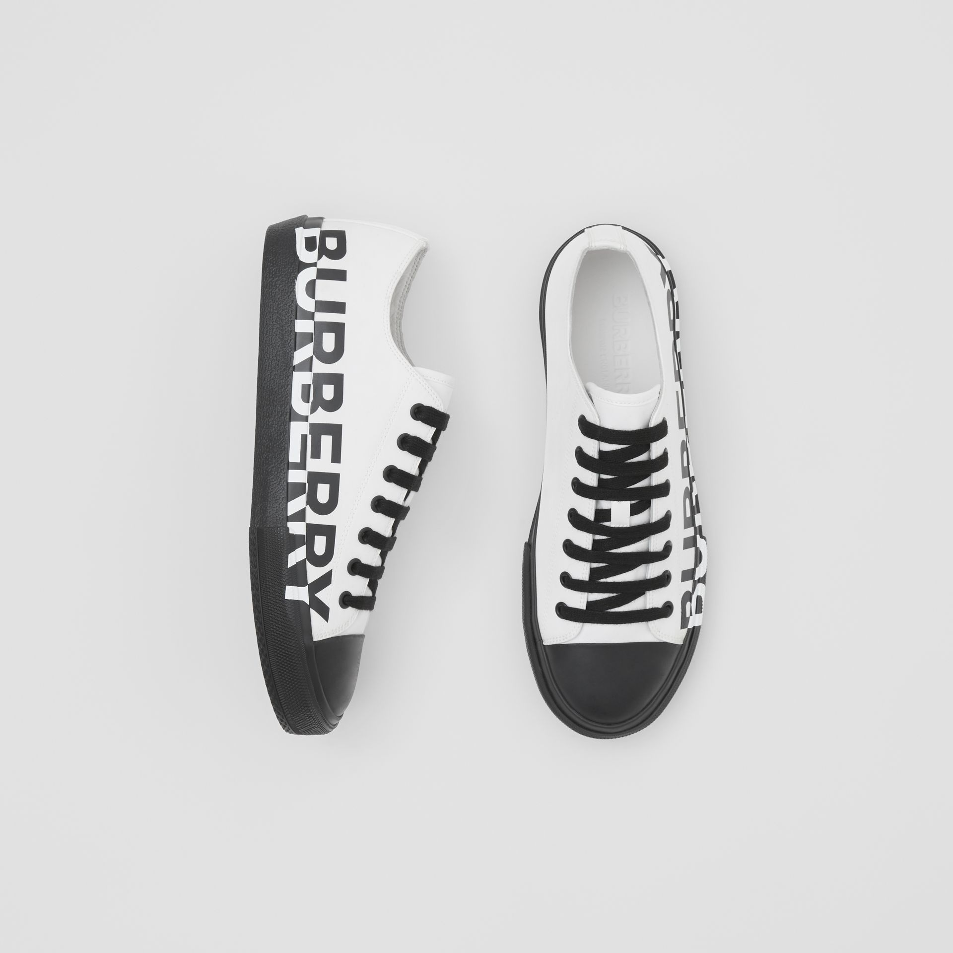 Logo Print Two-tone Cotton Gabardine Sneakers in Optic White/black - Men | Burberry Canada - gallery image 0