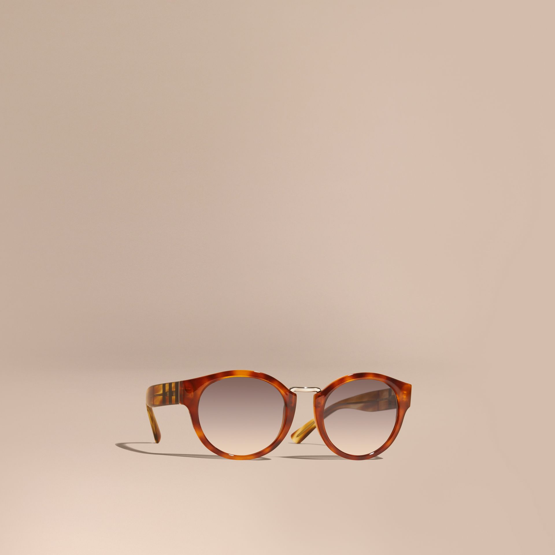 Check and Camouflage Detail Round Frame Sunglasses in Light Russet Brown - Women | Burberry Australia - gallery image 1