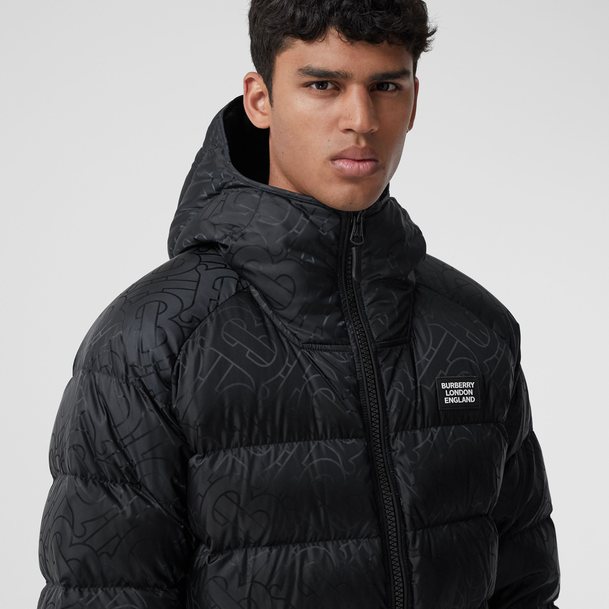 Monogram Jacquard Hooded Puffer Jacket in Black - Men | Burberry - 2