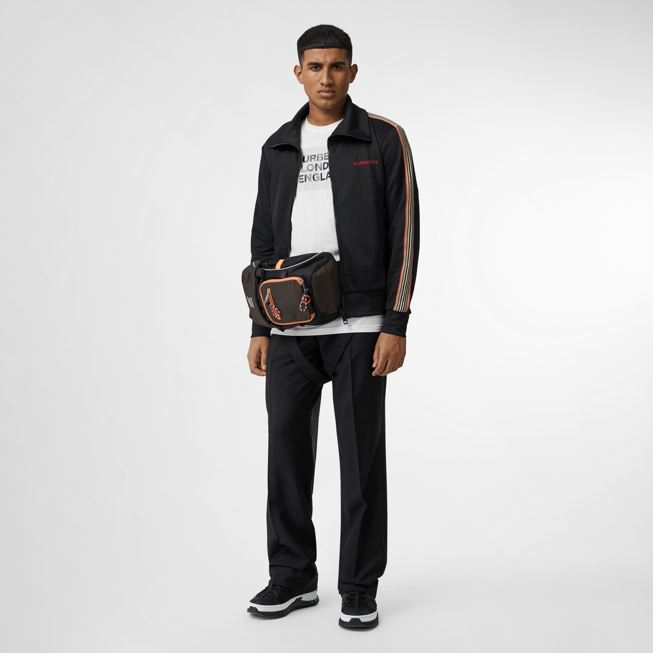 Icon Stripe Detail Funnel Neck Track Top in Black - Men | Burberry - 1