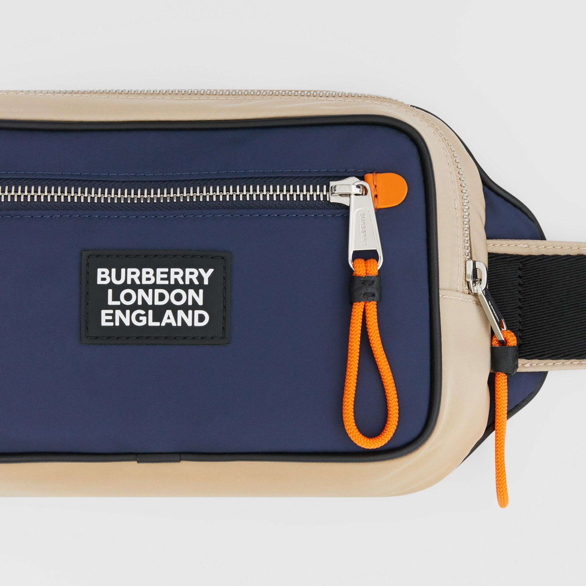 Logo Appliqué Two-tone ECONYL® Bum Bag in Regency Blue/bright Orange | Burberry United Kingdom - gallery image 1