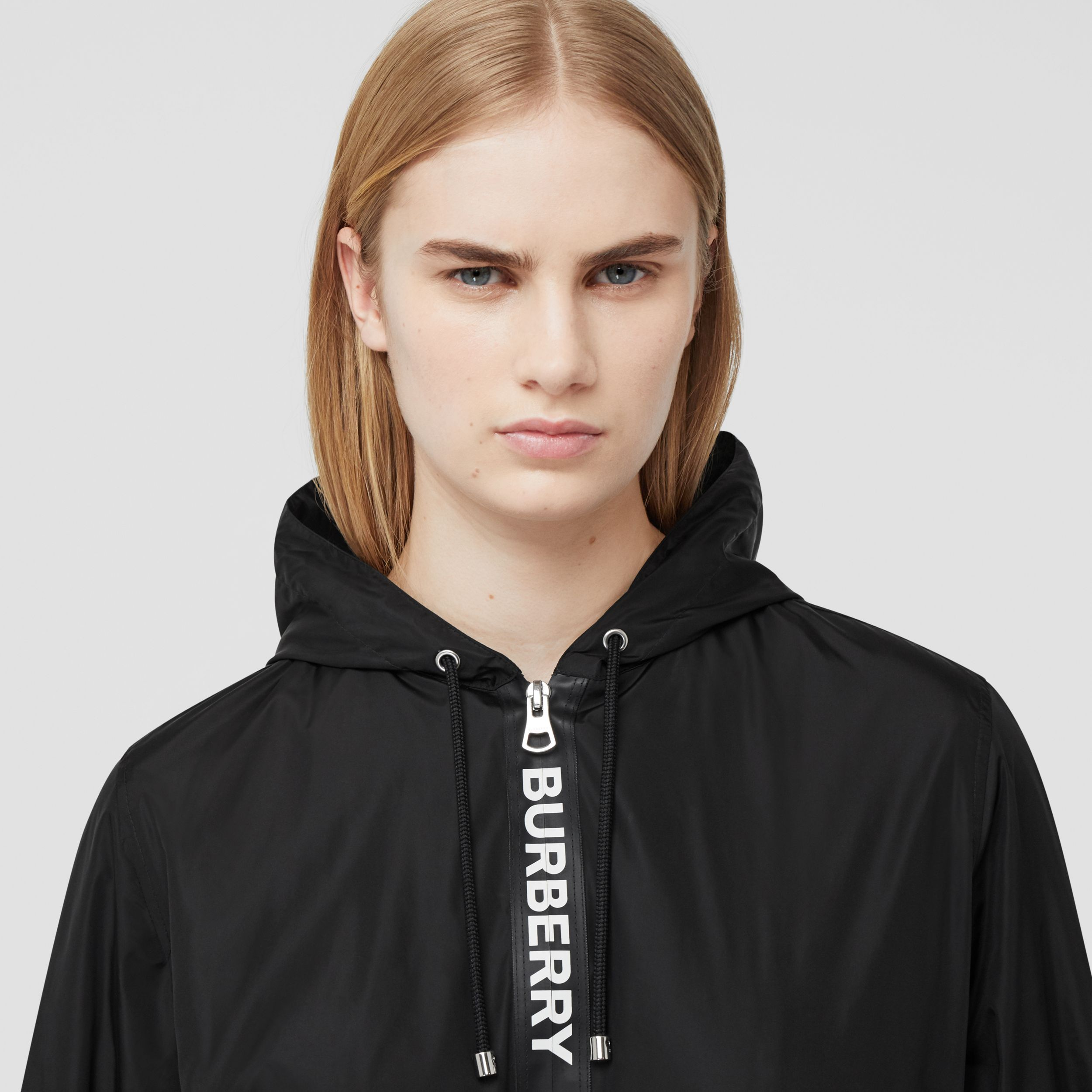 Logo Tape ECONYL® Hooded Jacket in Black - Women | Burberry Singapore - 2