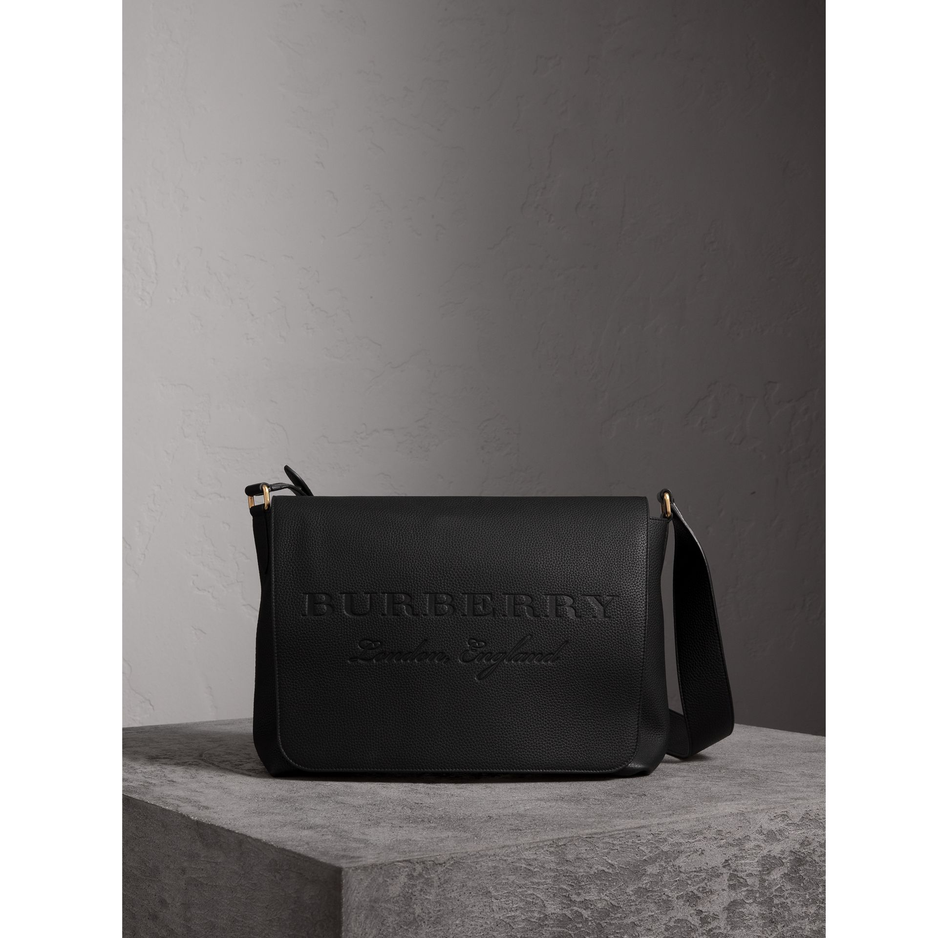 Large Embossed Leather Messenger Bag in Black | Burberry United States - gallery image 1