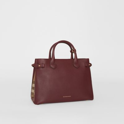 8edcf423fc99 the medium banner in leather and house check mahogany red women. BURBERRY