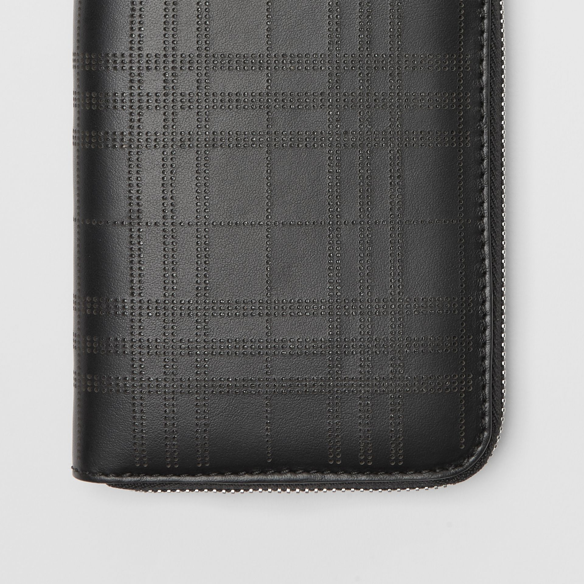 Perforated Check Leather Ziparound Wallet in Black - Men | Burberry - gallery image 1