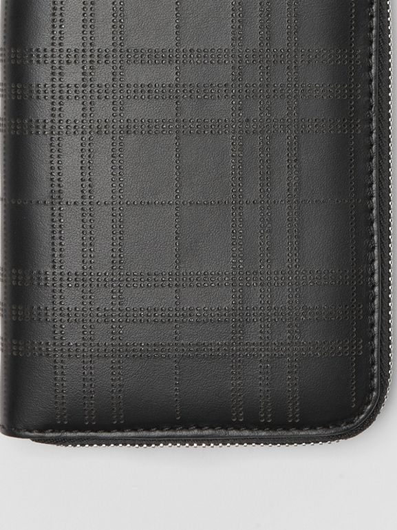 Perforated Check Leather Ziparound Wallet in Black - Men | Burberry United Kingdom - cell image 1