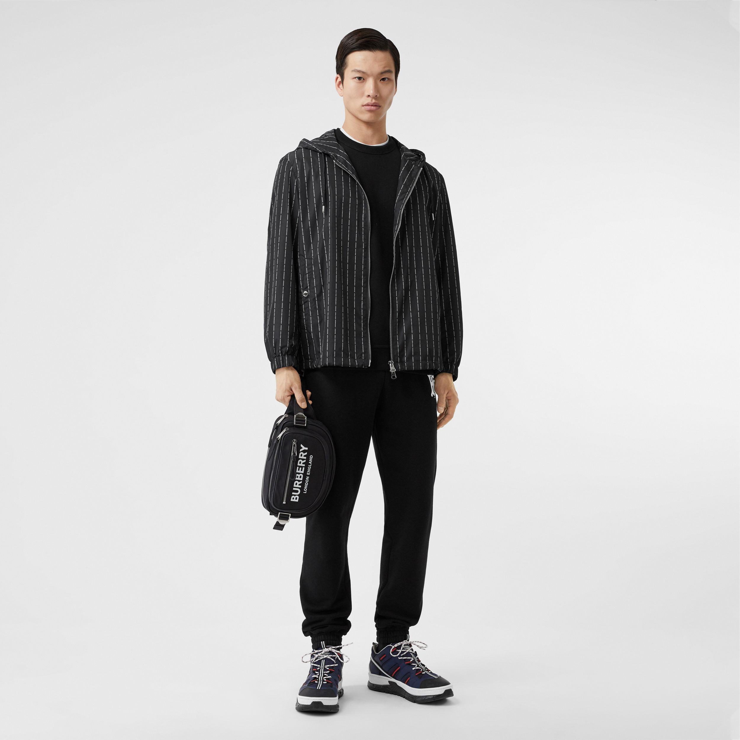 Logo Pinstripe Nylon Hooded Jacket in Black - Men | Burberry Canada - 1