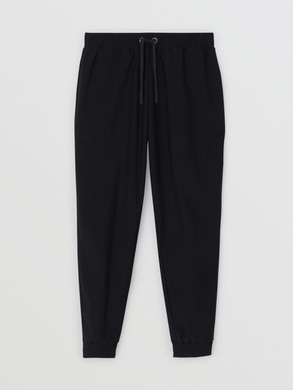 Logo Print Stretch Nylon Trackpants in Black