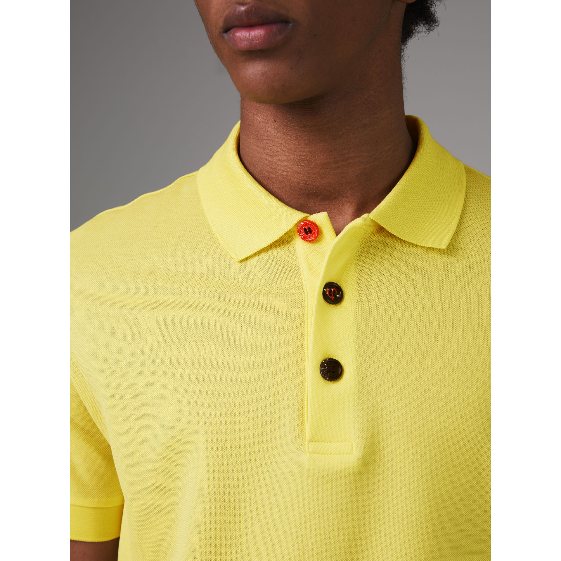 Painted Button Cotton Piqué Polo Shirt in Vibrant Lemon - Men | Burberry United Kingdom - gallery image 1
