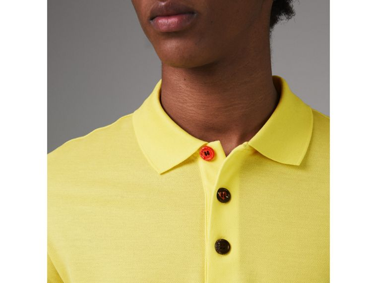 Painted Button Cotton Piqué Polo Shirt in Vibrant Lemon - Men | Burberry United Kingdom - cell image 1