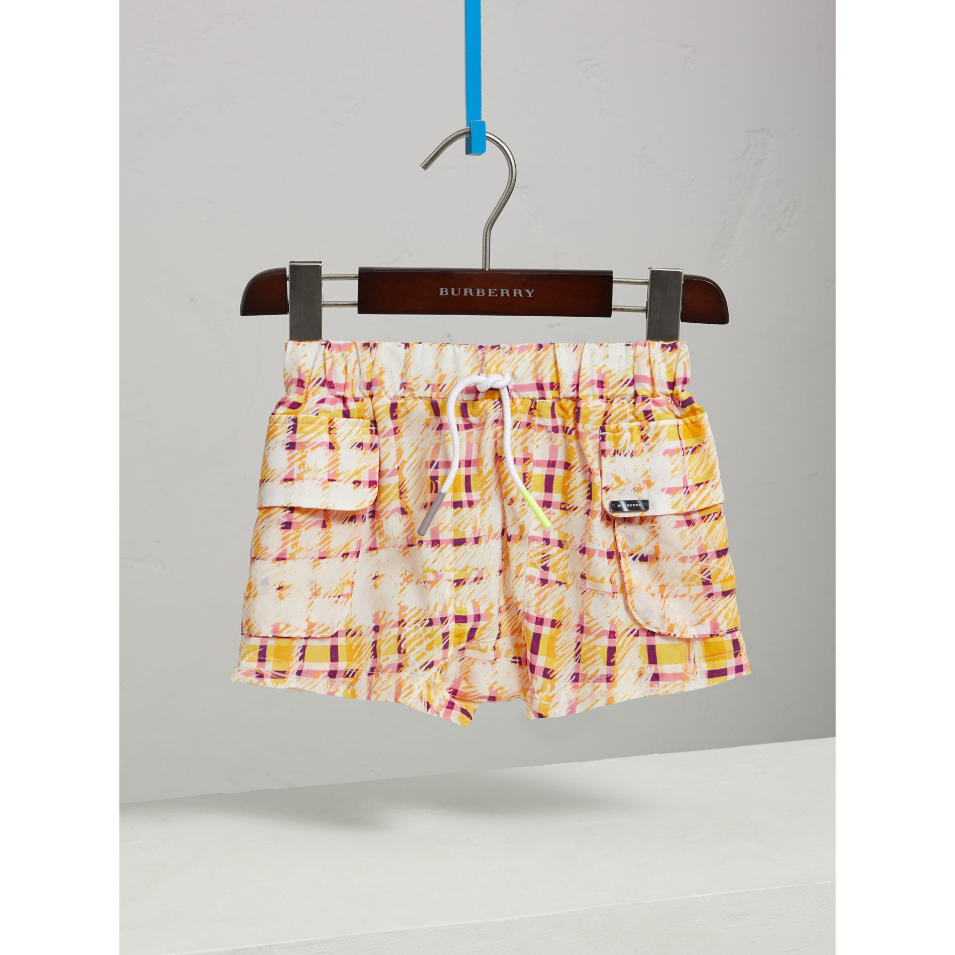 Scribble Check Silk Drawstring Shorts in Amber Yellow - Girl | Burberry - gallery image 0