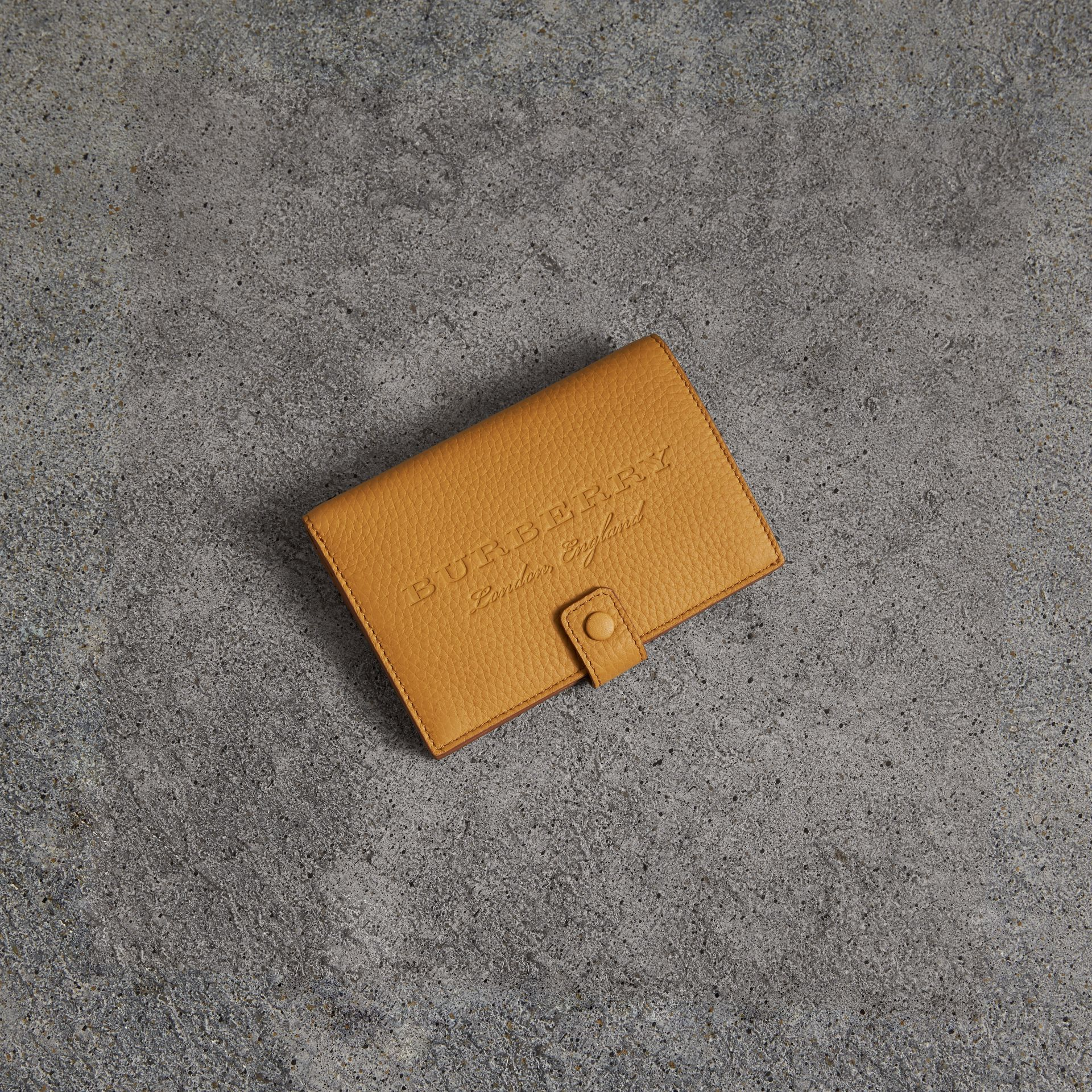 Embossed Grainy Leather Folding Wallet in Ochre Yellow - Women | Burberry - gallery image 0